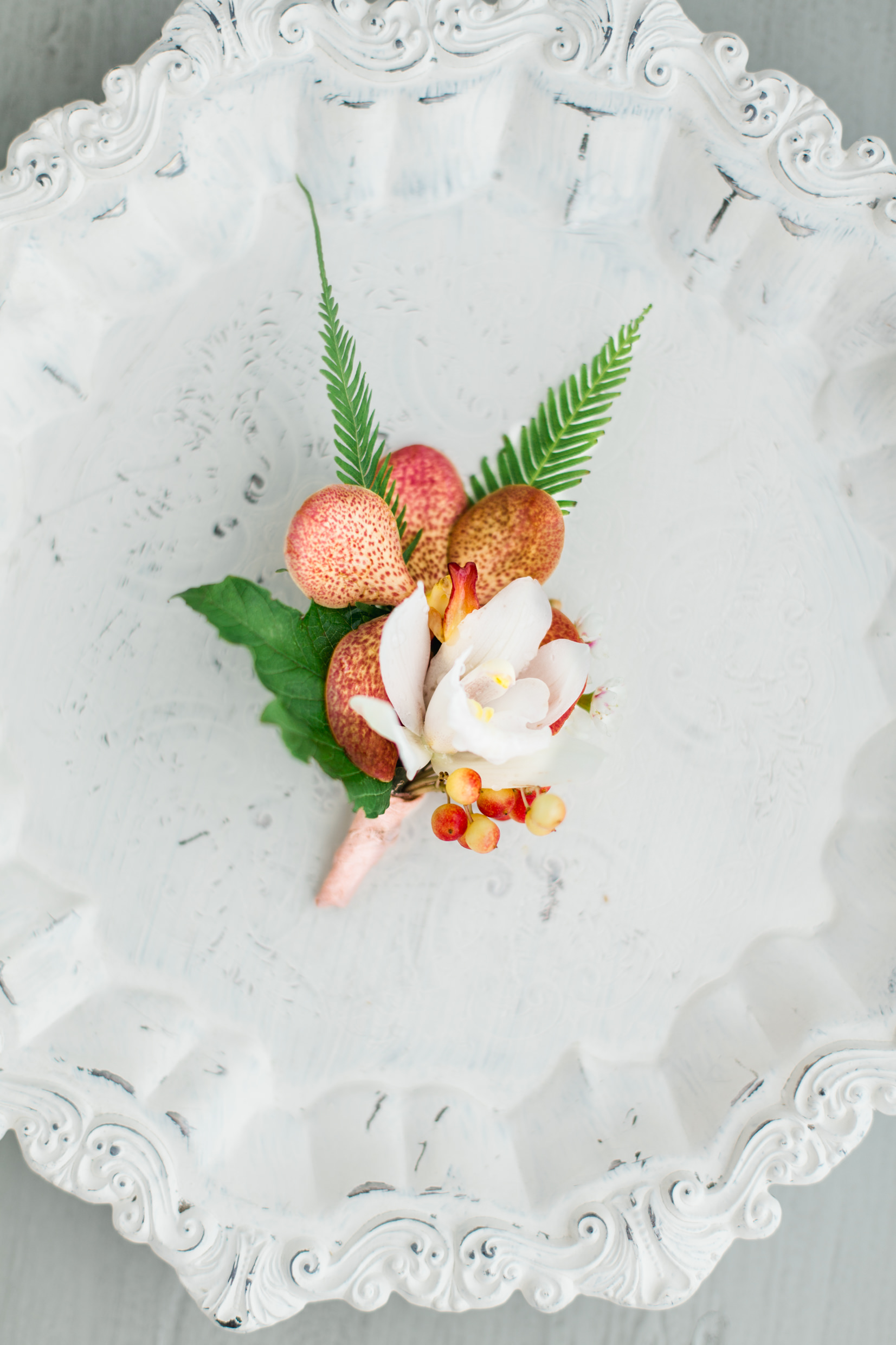tropical inspired boutonniere.jpg