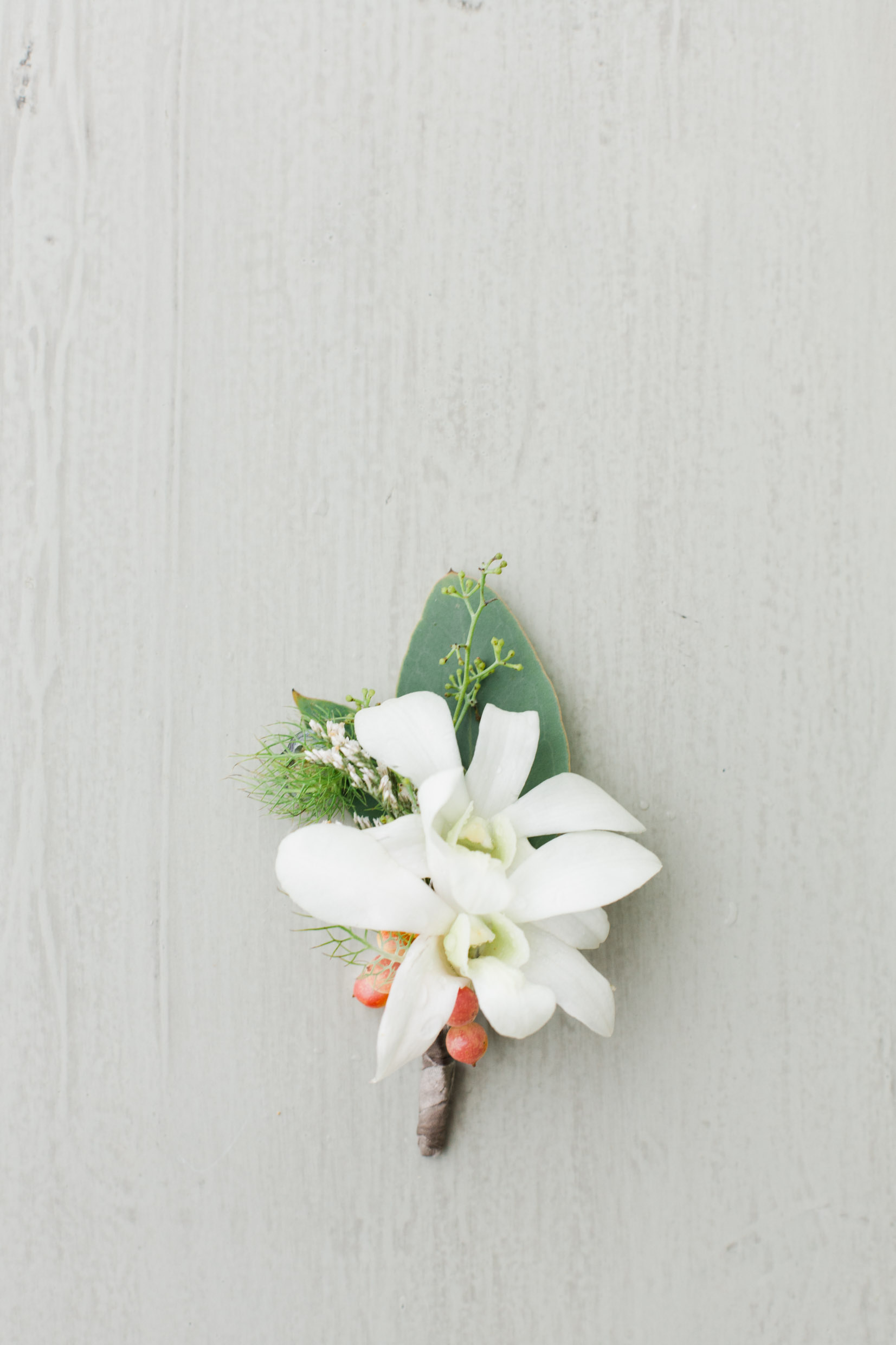 White Orchid Boutonniere.jpg