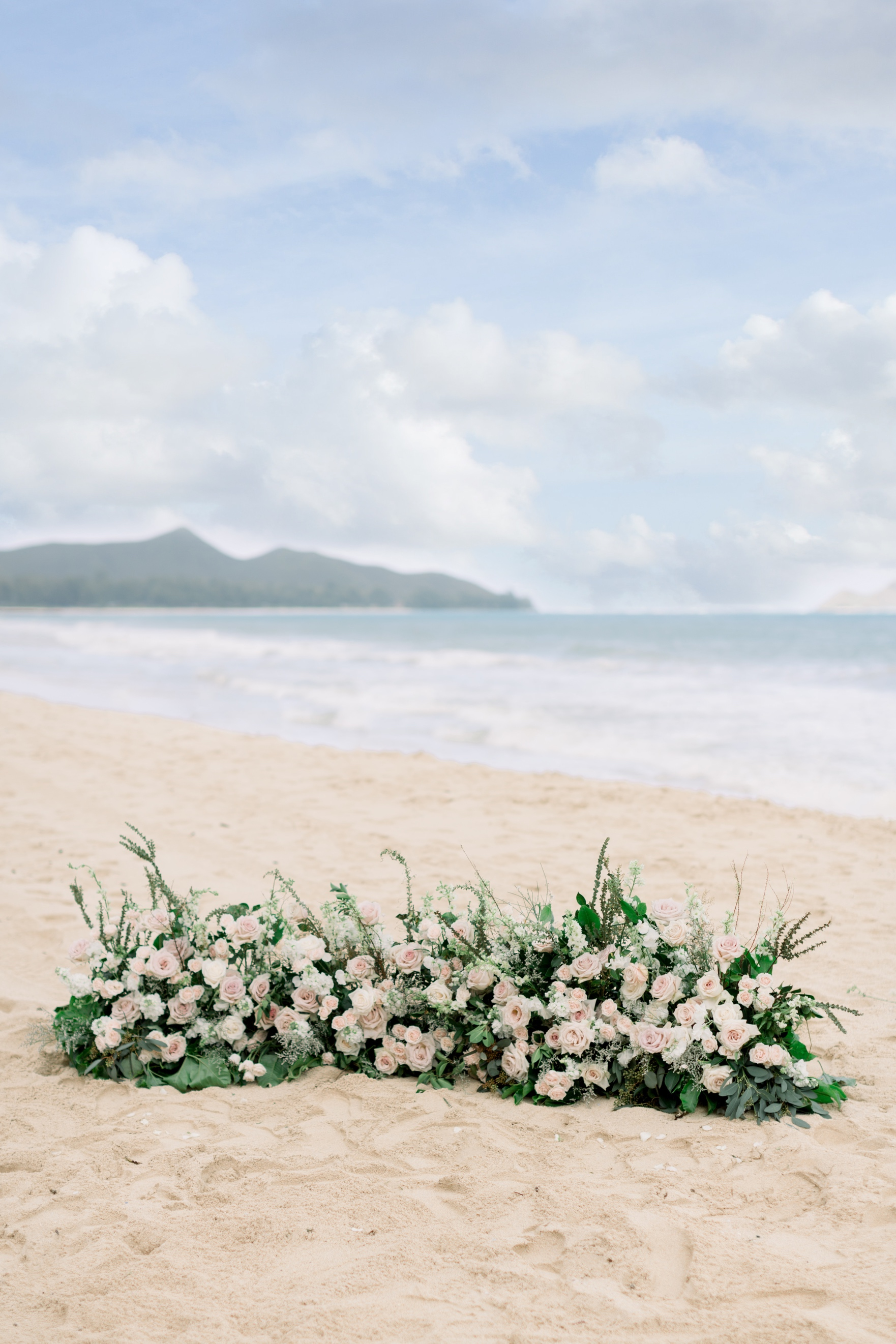 Ceremony Ground Florals on hawaii beach.jpg