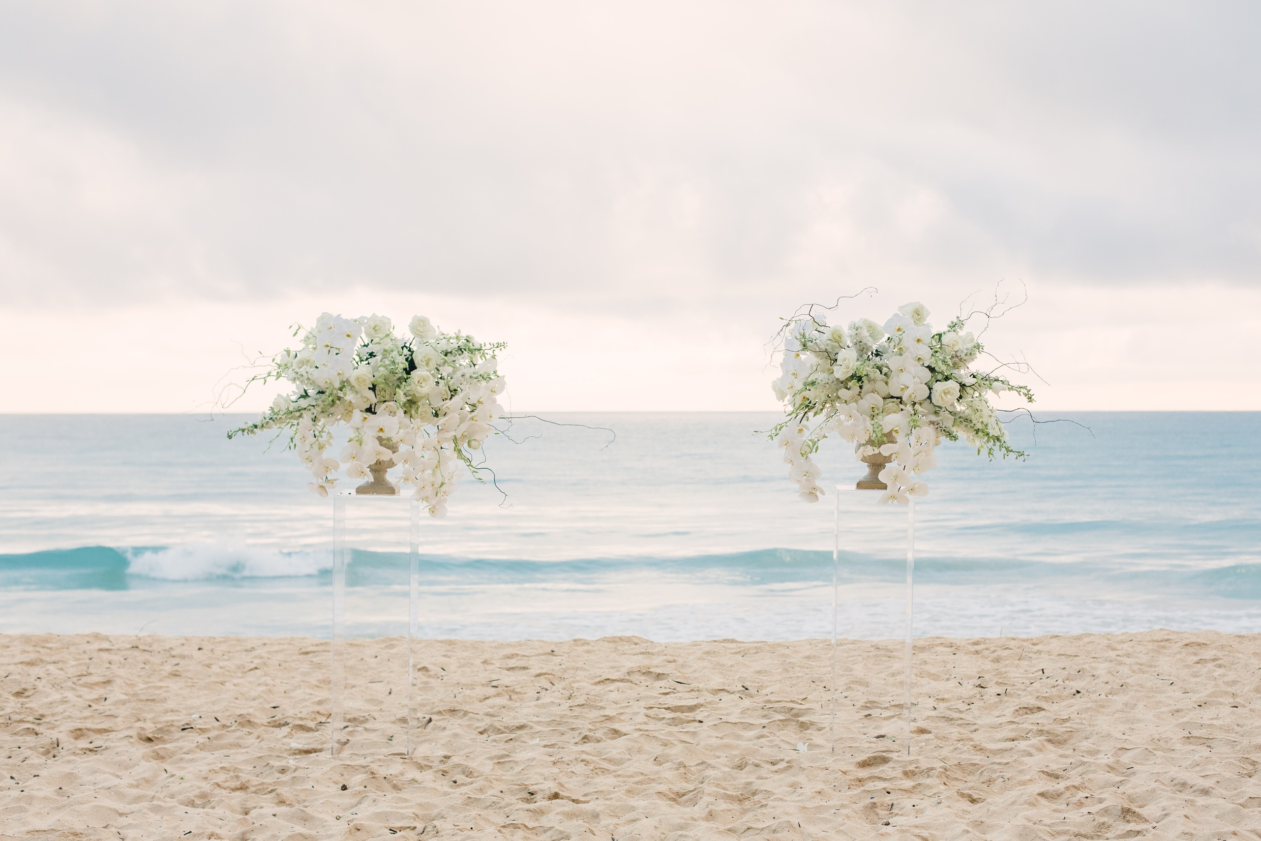 white orchids ceremony flowers on beach hawaii.jpg