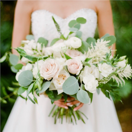 A classic garden bouquet with roses, astilbe, listianthus, eucalyptus & botanical foliages.