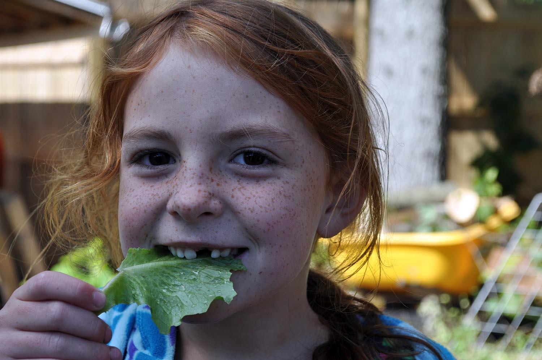 TES kid with lettuce leaf.JPG