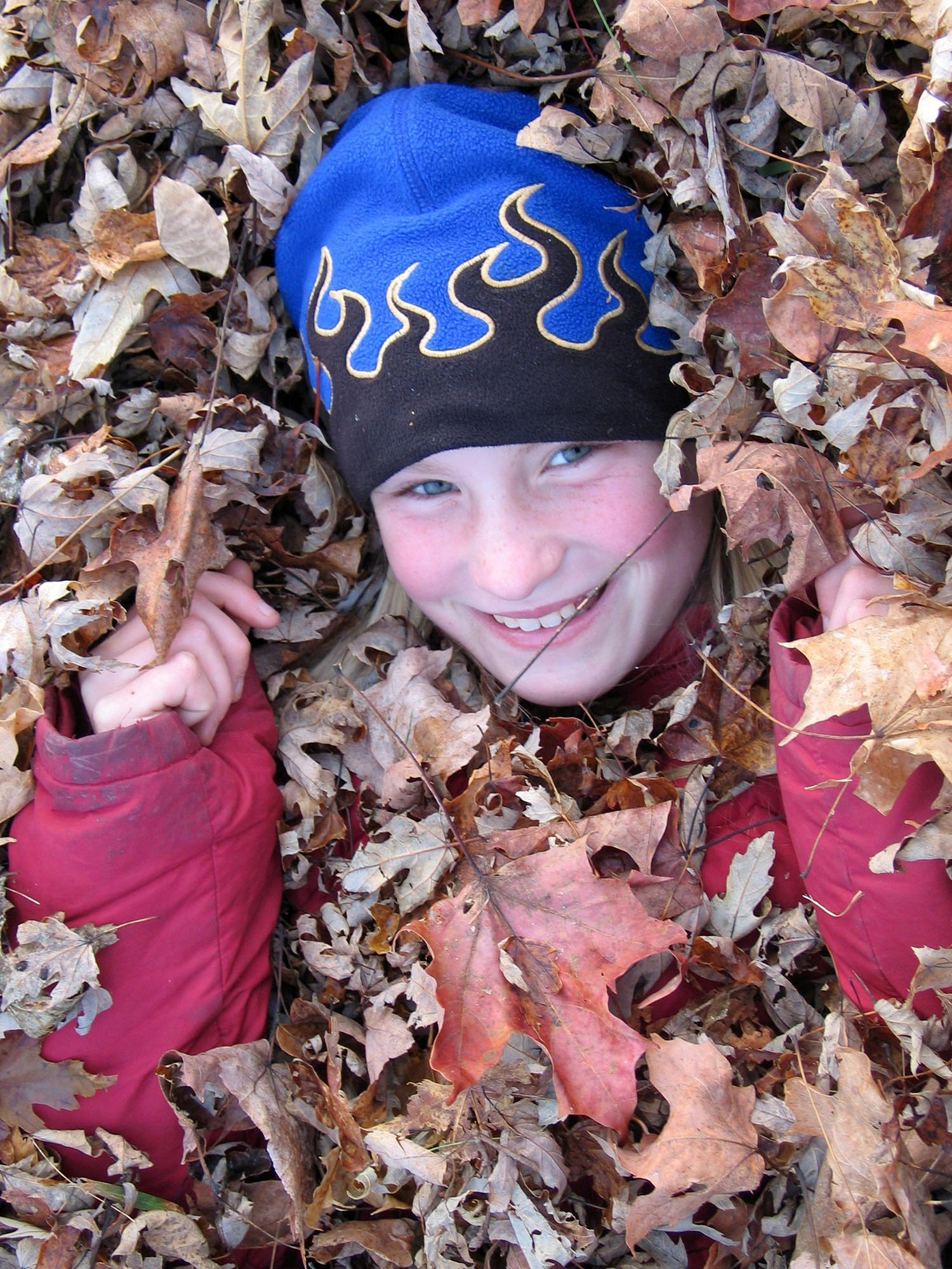 Copy of kid in leaves.jpg
