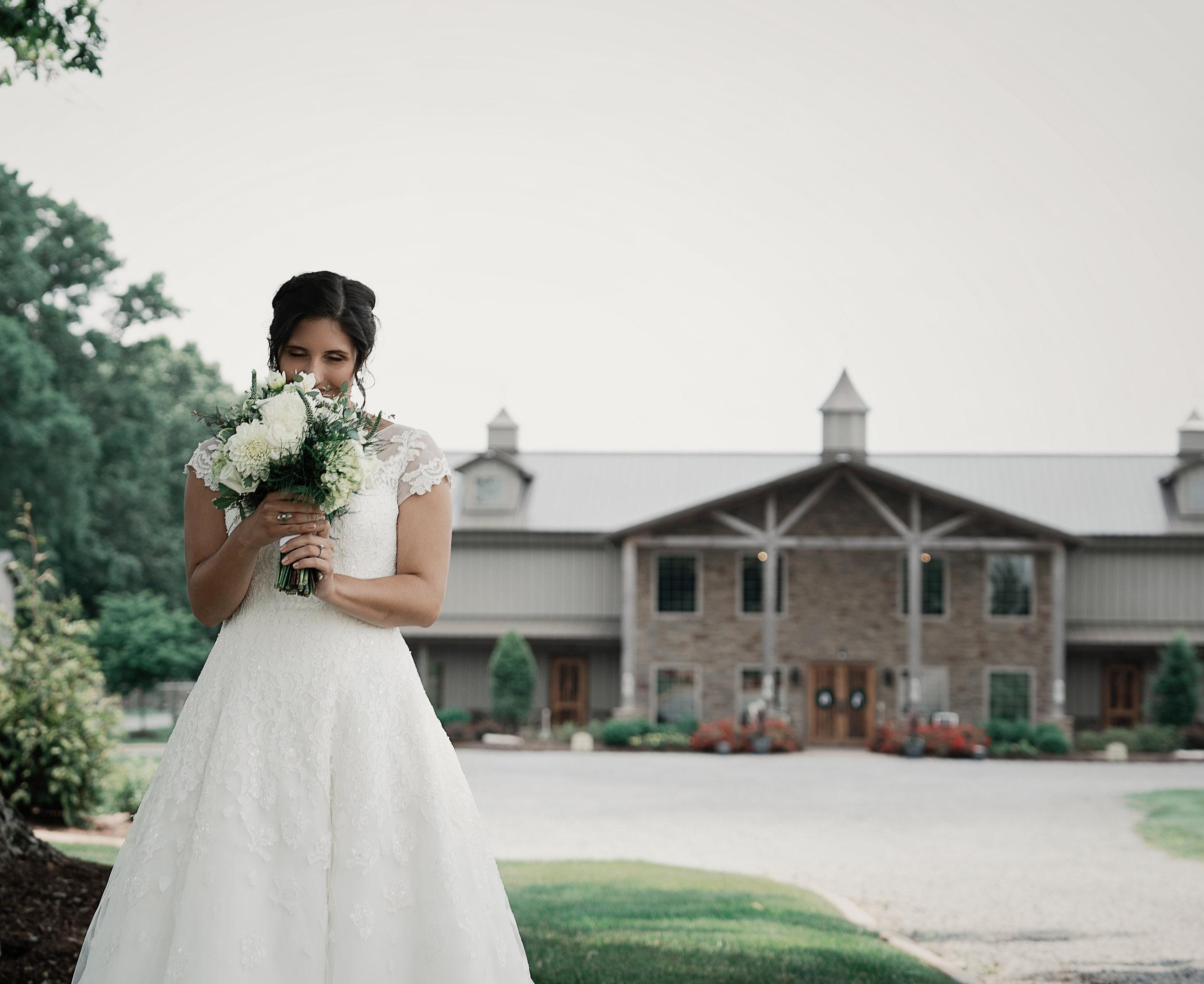 Bride in front of barn.jpg