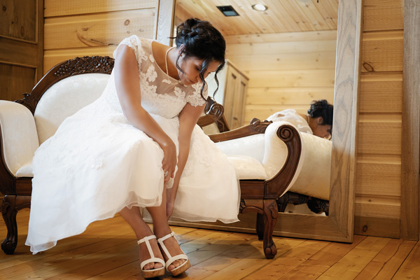 """Bridal Suite - The private upstairs areas house the multi room Bridal Suite with every possible amenity: private dressing areas, a large lounge, even """"stylist chairs"""" for hair and makeup. The Groom's Room has comfy sofas and a large screen TV. Private bathrooms with showers are in both."""