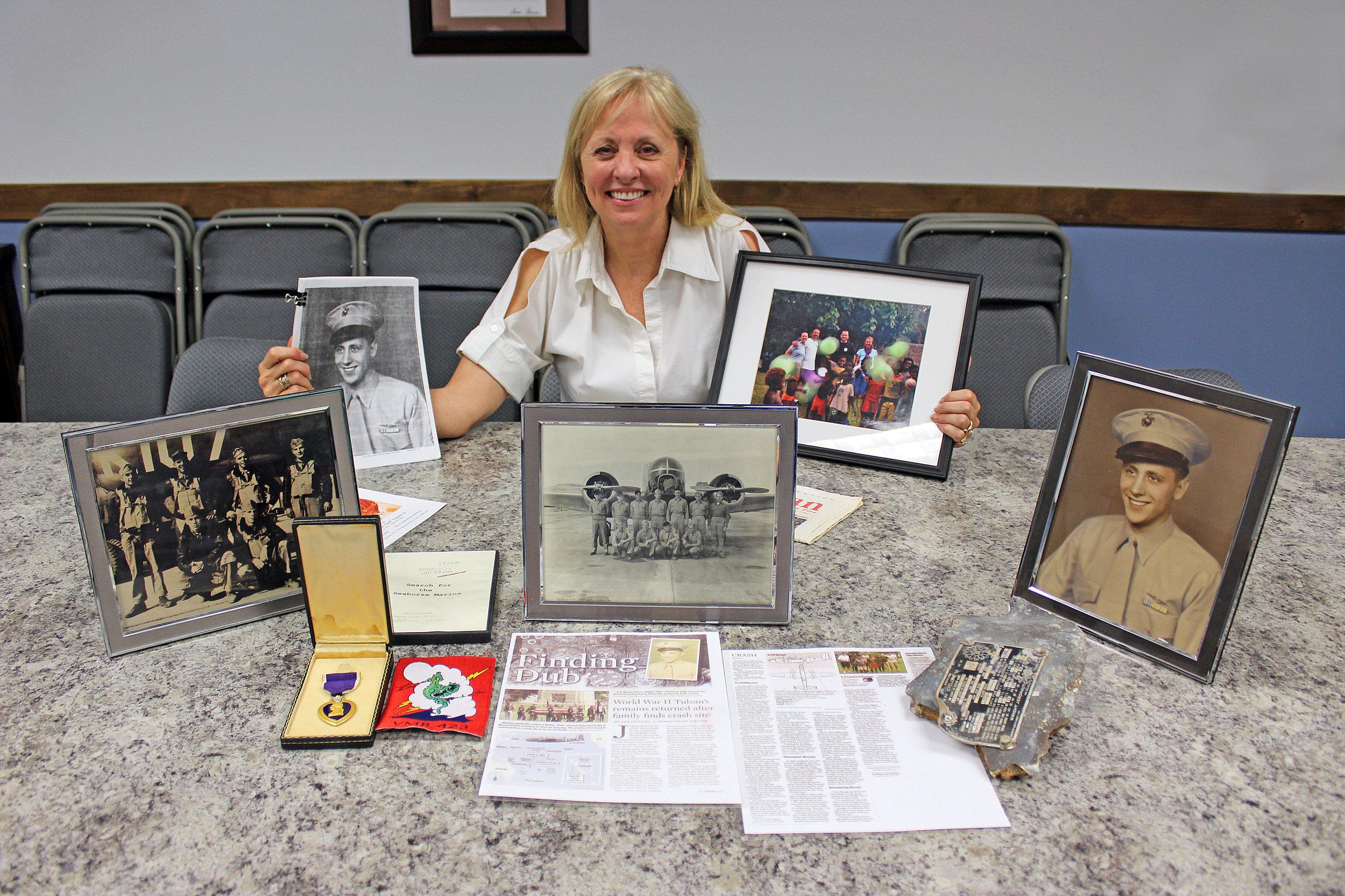 "Kim Anderson – Lucas resident, Kim Anderson, displays mementos of her uncle, 2nd Lt.   Walter ""Dub"" Burt Vincent Jr."