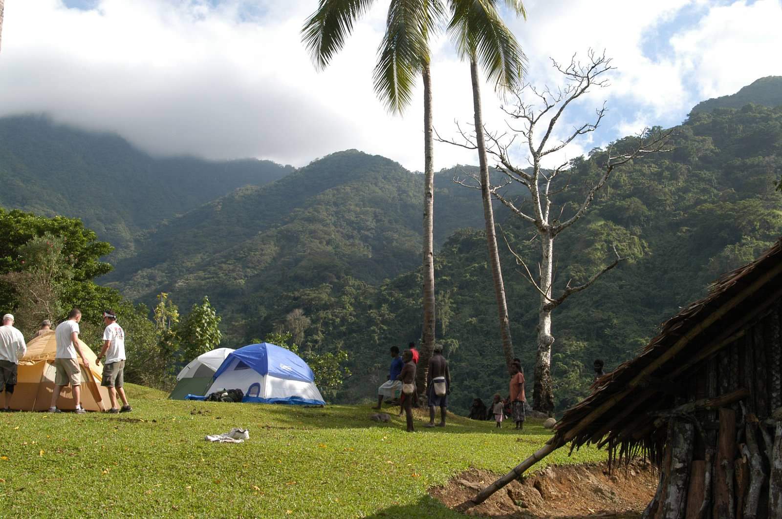 - June 2007, Maljia Village with Mount Tabwemasana (where plane was found)in background. Base camp in the sky. (Photo provided by Kim Anderson.)