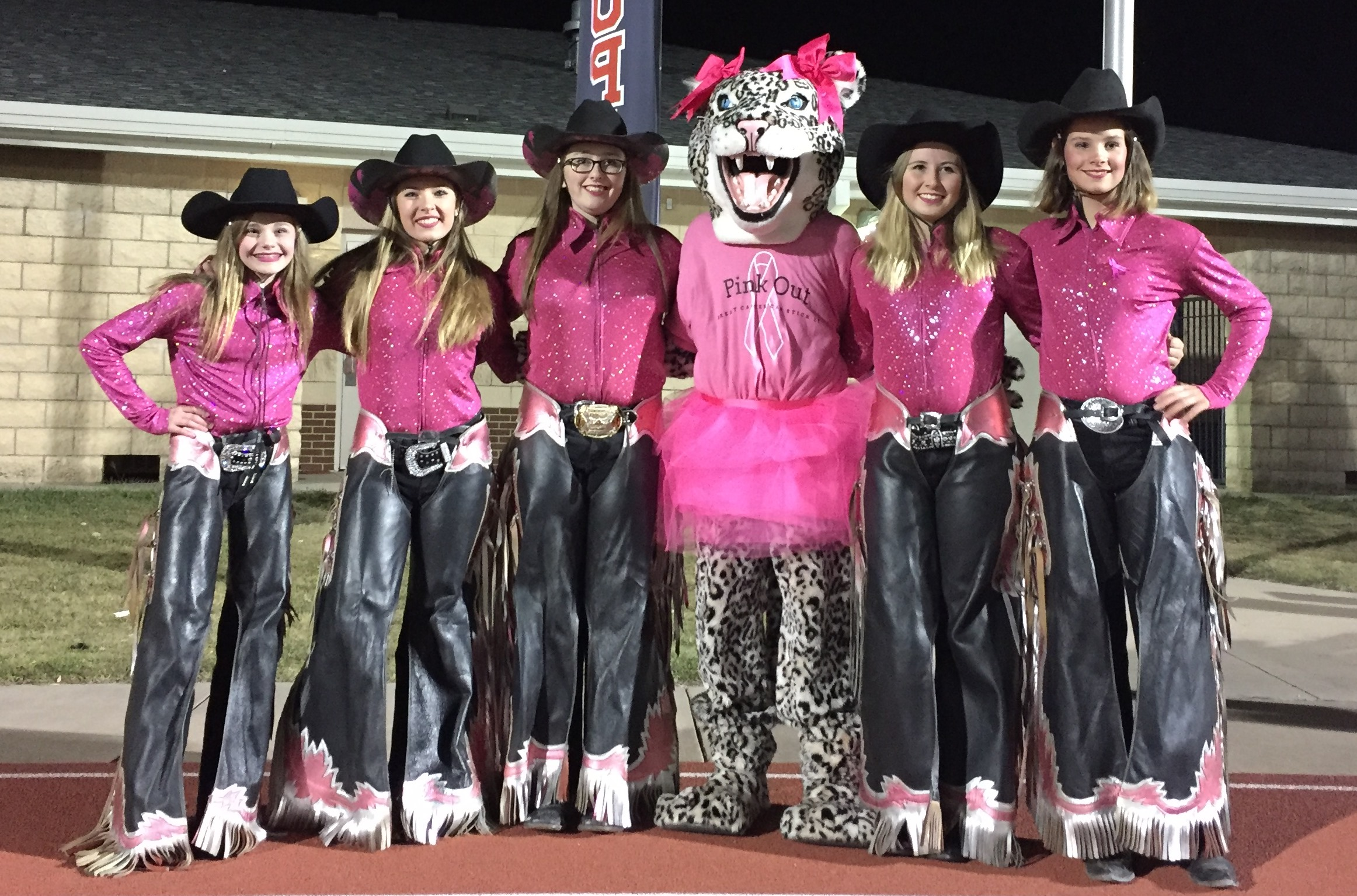 Members of the Woodhaven Wranglers at the Lovejoy High School Pink Out football game. (l to r) Sarah Muckelroy, Taylor Braun, Sierra Stammen, Casey Perkins and Clementine Brown.