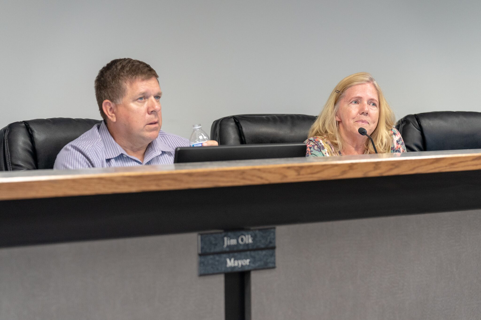 Mayor Jim Olk (L) and Mayor Pro Tem Kathleen Poole (R) explain that annexation allows Lucas to control important development issues.