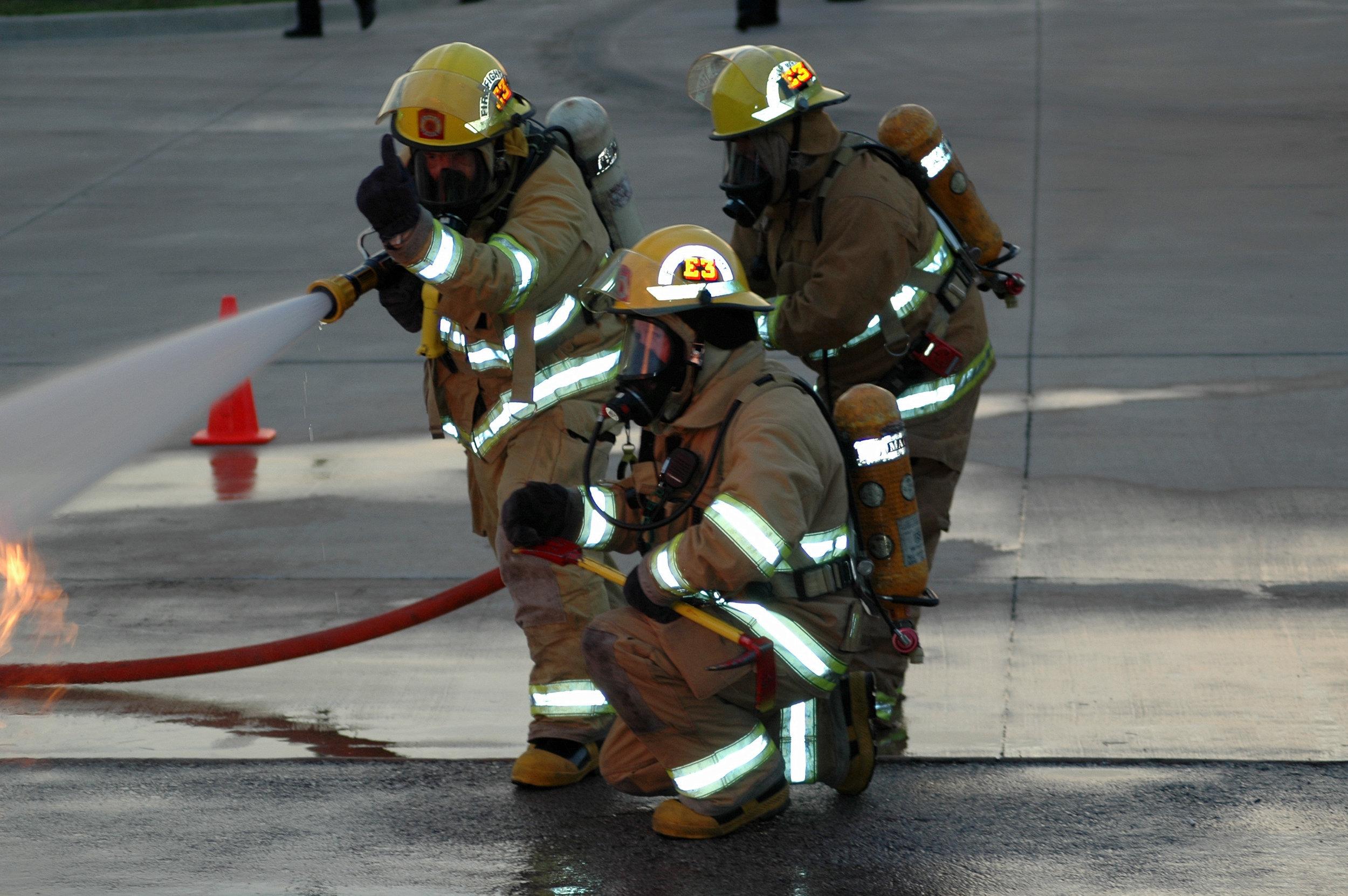 David Leonard crouched preparing to enter a Live Burn Training.