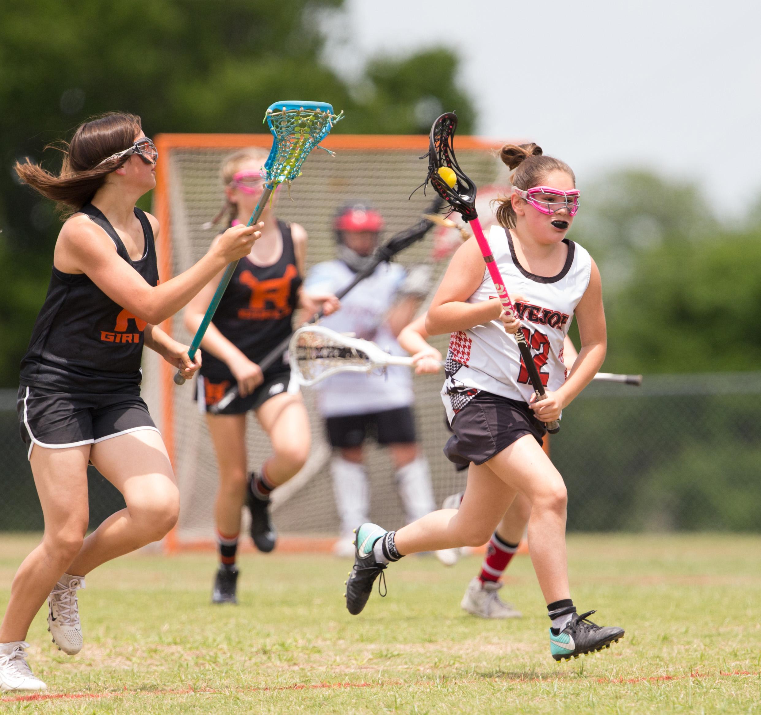 Rising 7th grader, Claire Diaz, cutting through the Rockwall defense.