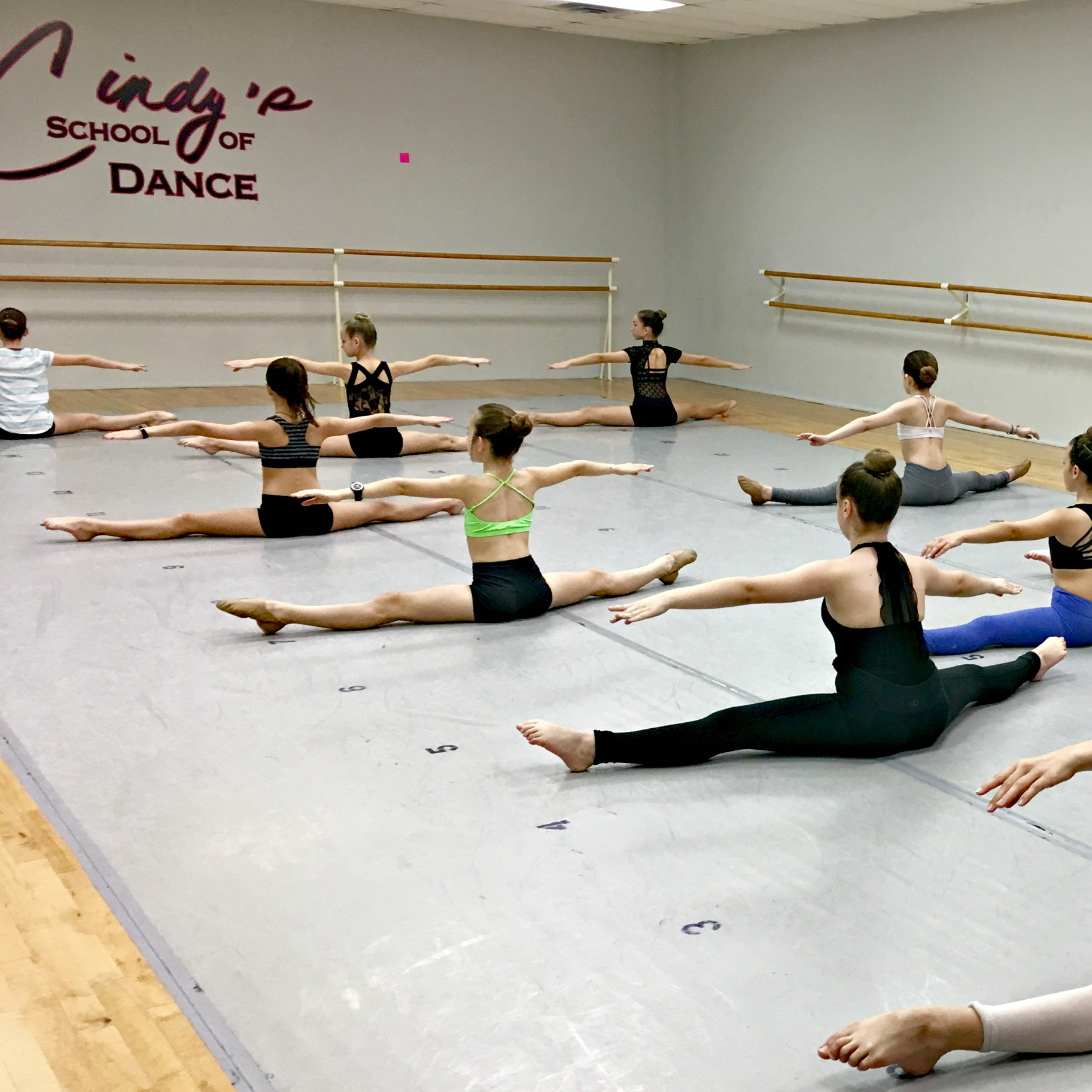 Dancers warm-up prior to class.