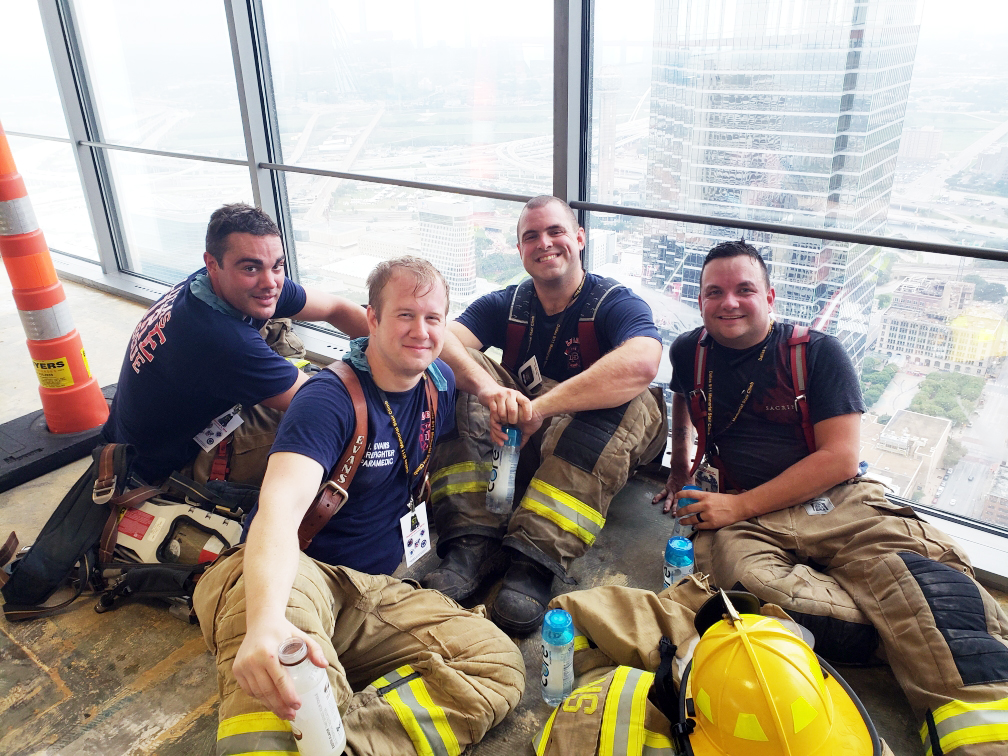 Members of Lucas Fire Rescue Department during the mid-climb break. They had climbed 55 floors and had 55 floors remaining.