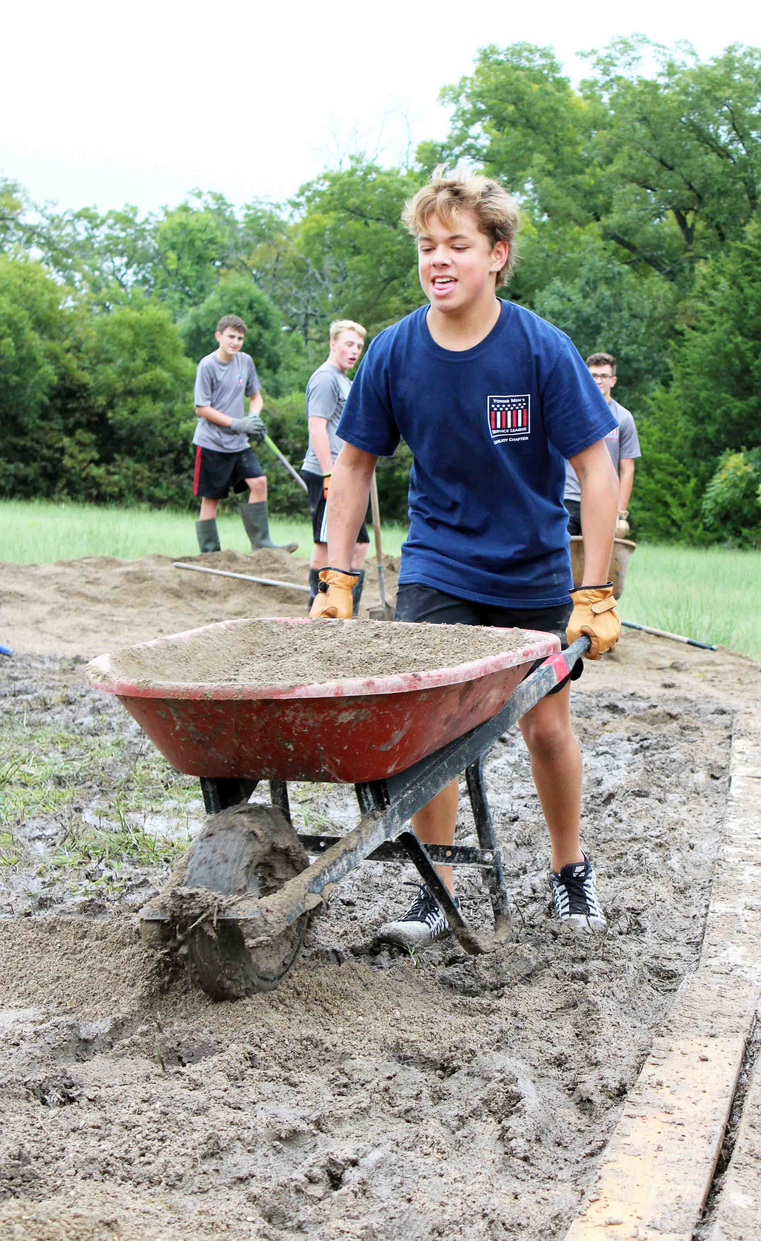 Collins Archer muscles through the mud to move gravel.