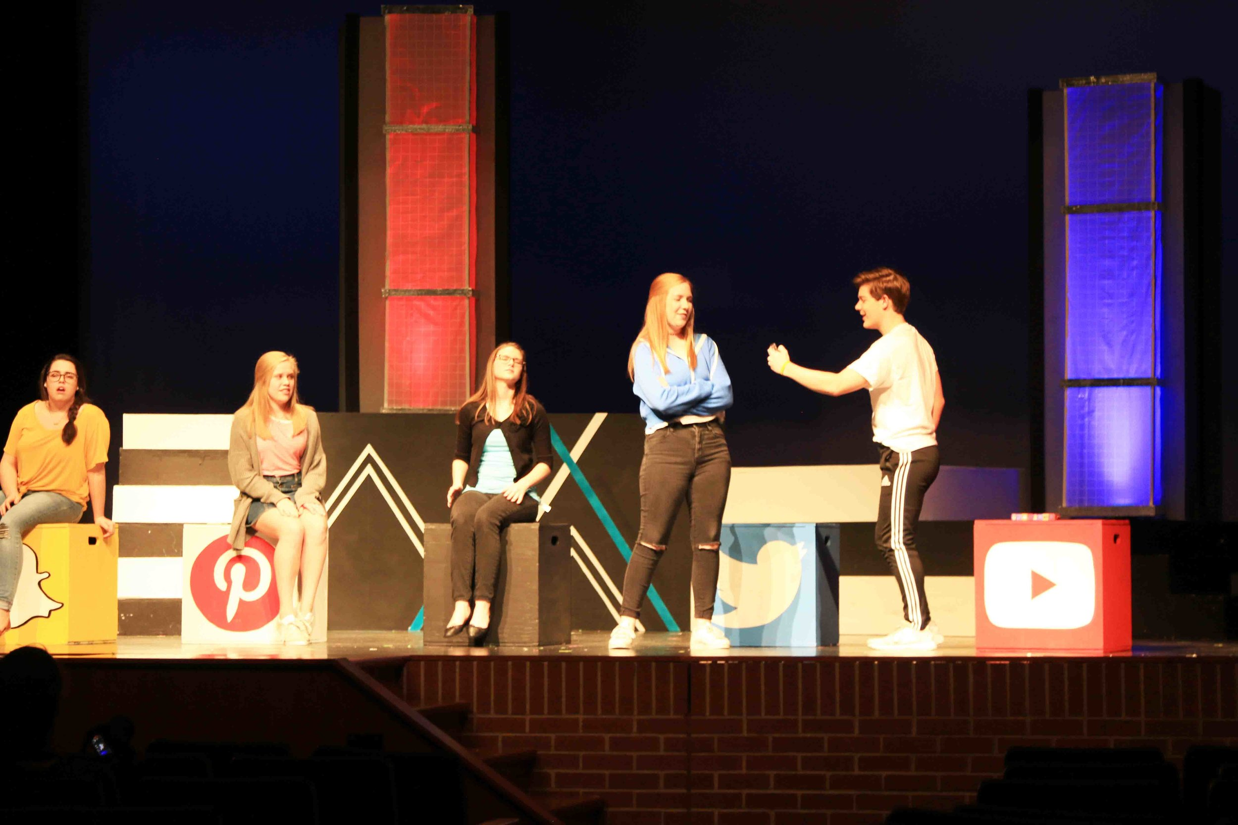 "(From left) Riley Bergwall, Emma Boland, Julia Dobbs, Sylvia Hansen and Alec Welhouse - ""Social Media"" characters of Twitter and YouTube arguing who is the better social media platform."