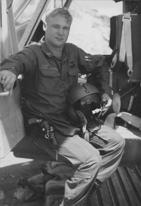 L. Michael Mints was a 21-year-old aircraft commander when this photo was taken in 1969. He is in a Bell UH-1H on a landing zone in Pleiku, Vietnam