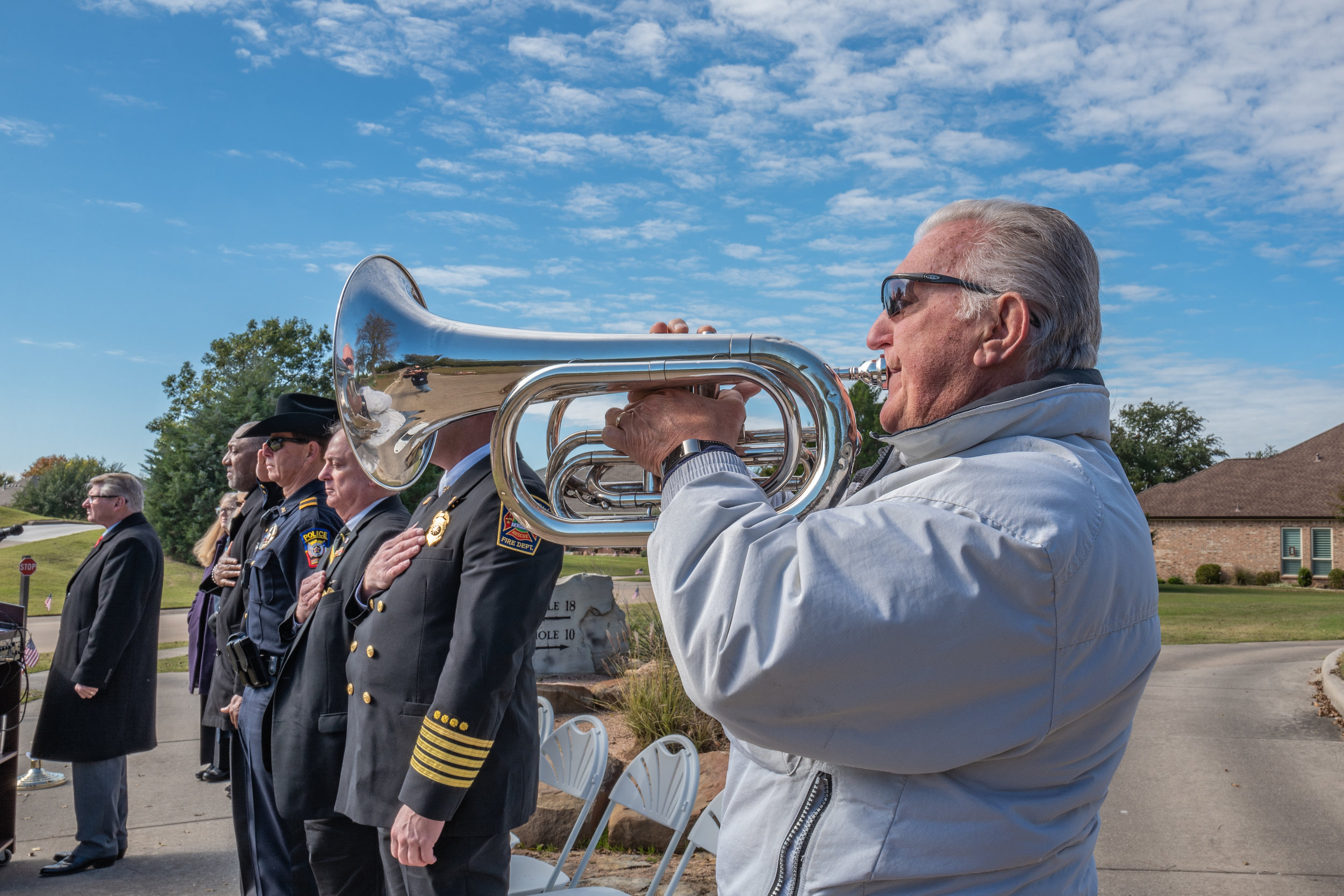 Heritage Ranch resident Al McGee plays Taps to conclude Flags of Honor ceremonies.