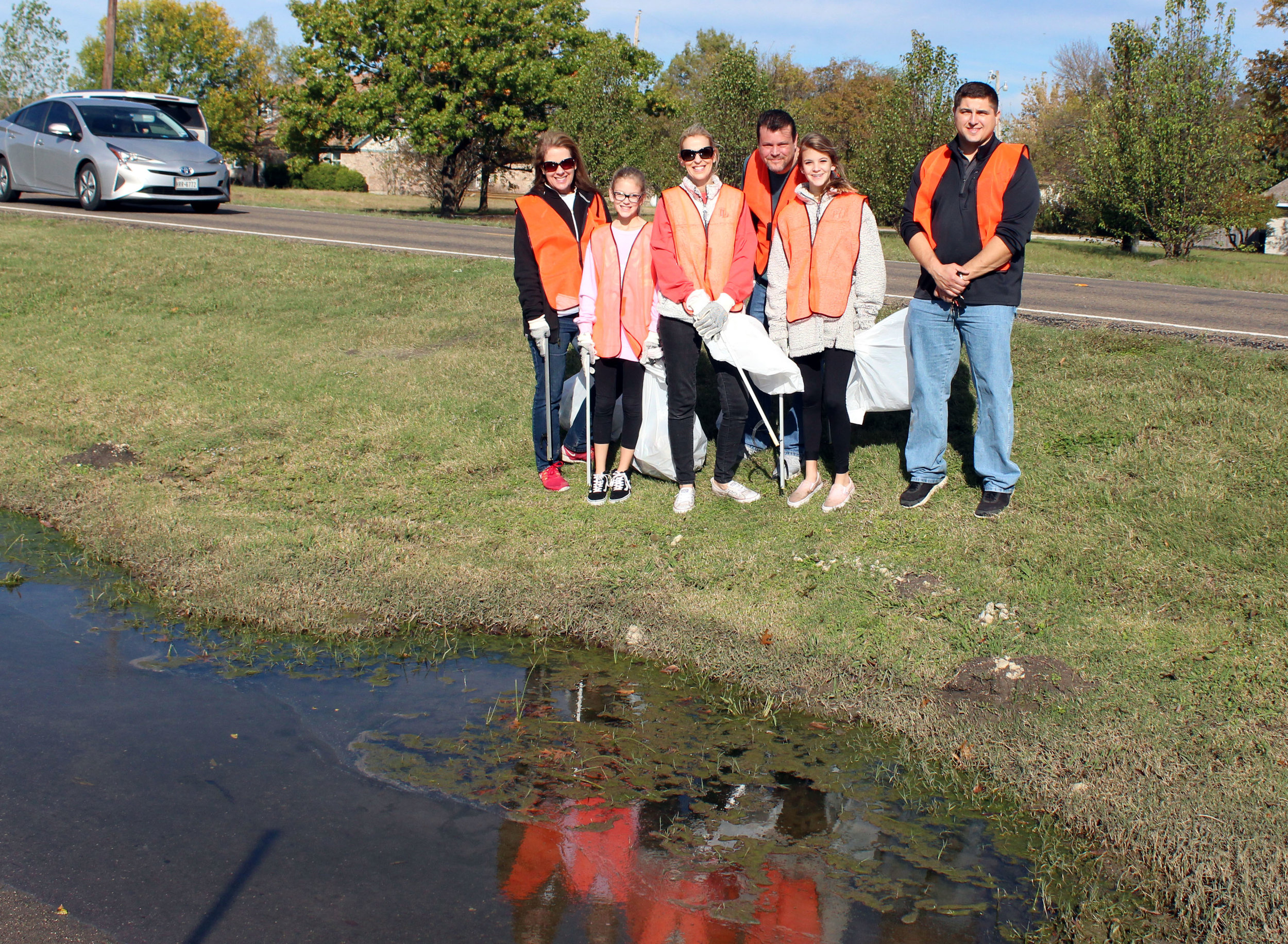 A clean-up crew worked on Estates Road in front of Grace Church. (From left) City of Lucas Parks and Open Space board member Debra Guillemaud, The Zadorozny Family – Presley, Becky, Dan and Piper and City of Lucas employee Anthony Aguinaga.