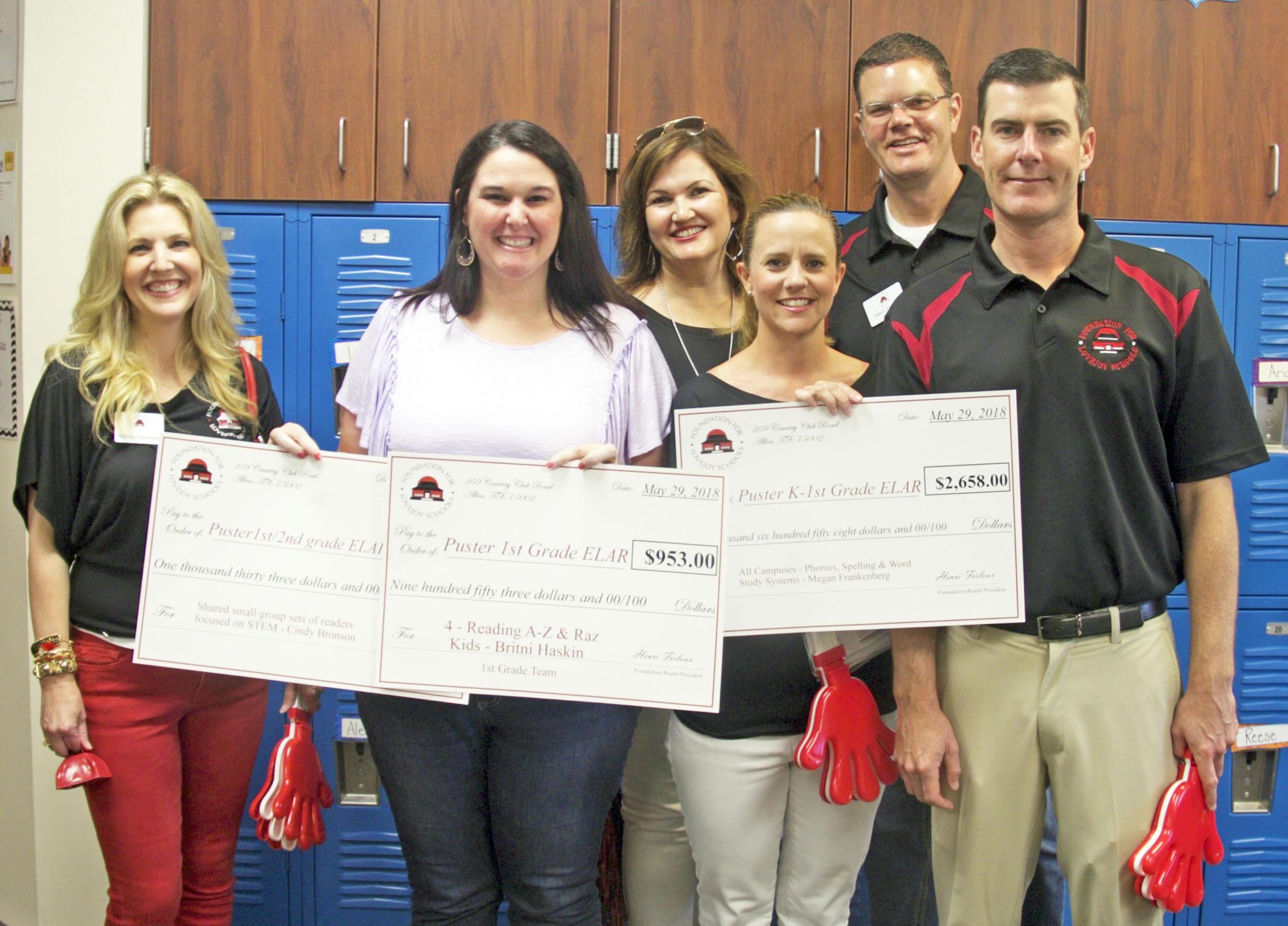 Board of Directors of the Foundation for Lovejoy Schools Grant Patrol with a teacher who received a grant at Puster Elementary.