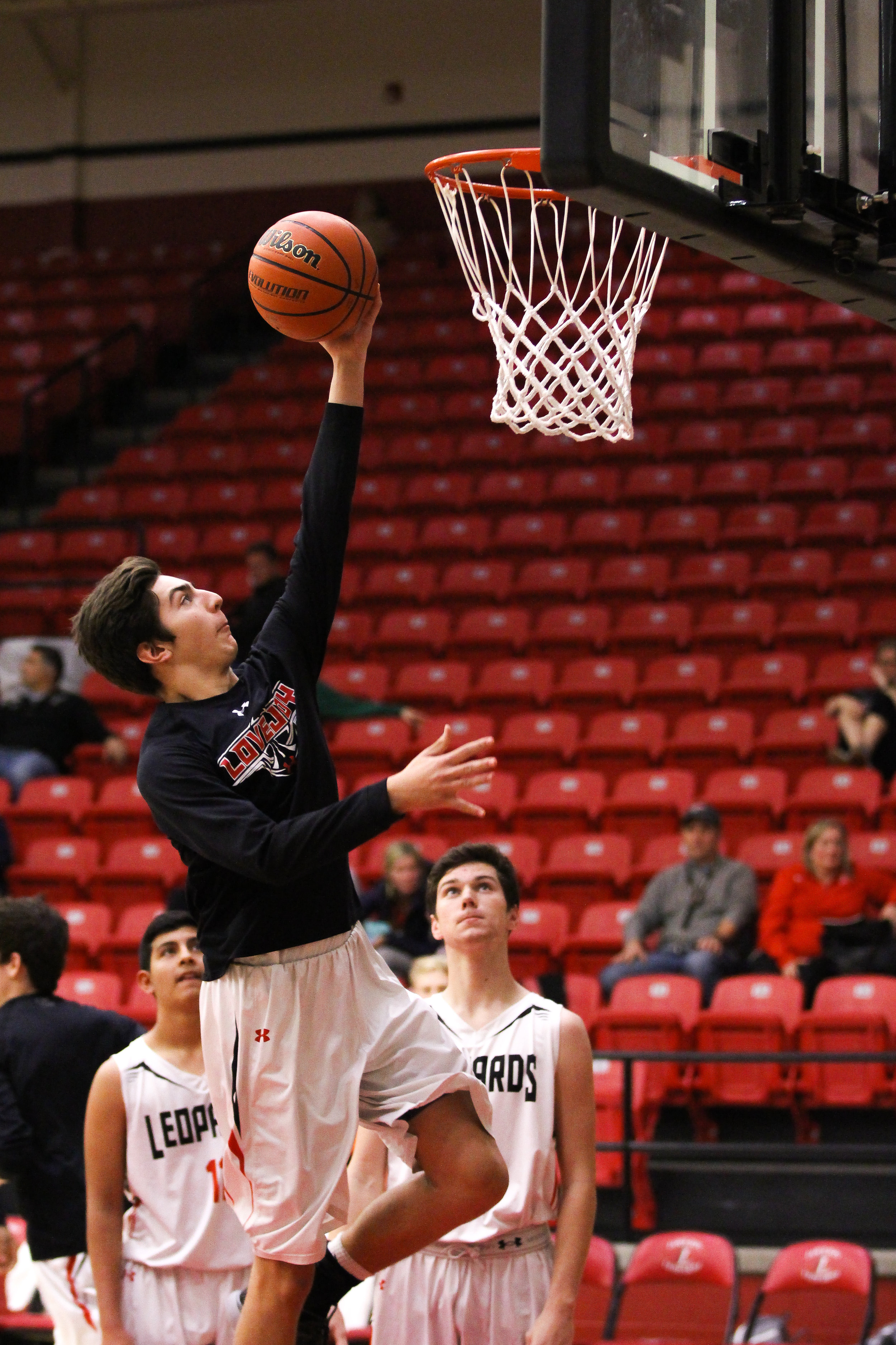 1 - Drew Bliven (33) sets up for a layup during warmups as he prepares for the game against Celina..jpg