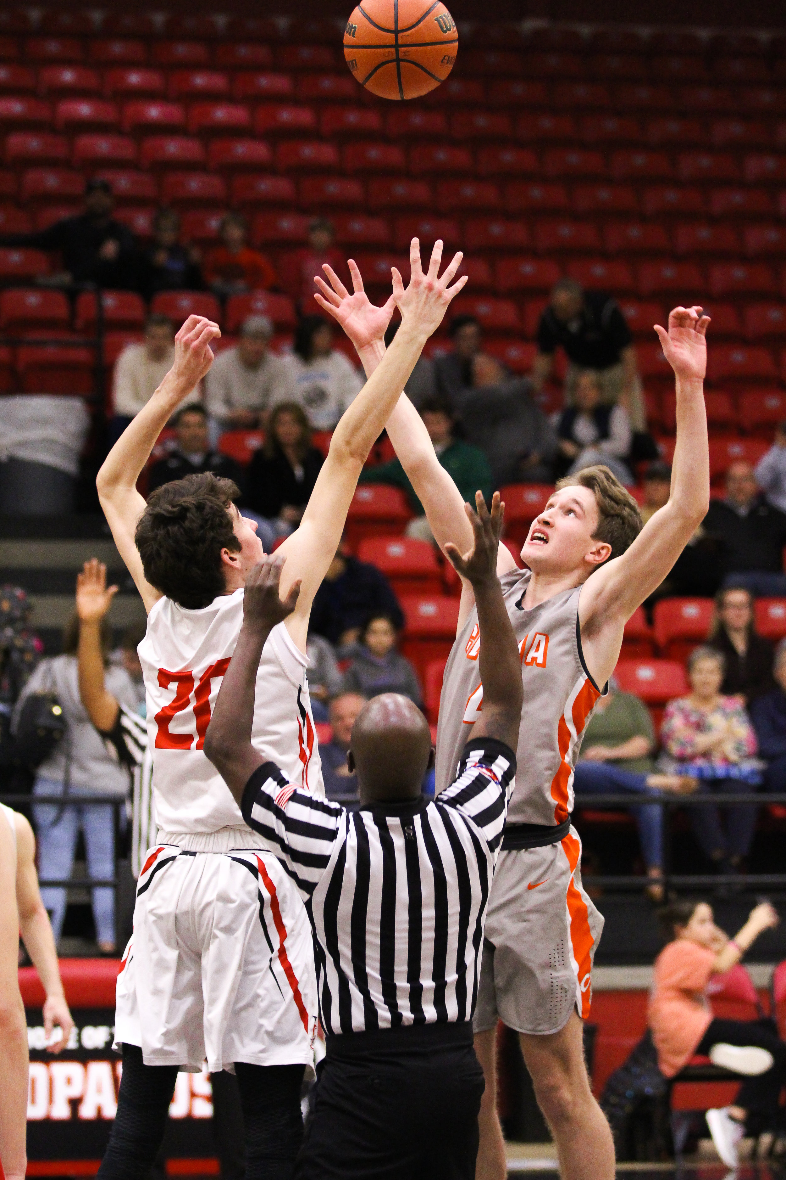 2 - Pete Peabody (20) elevates in attempts to win the ball in the tip off at the start of the game..jpg