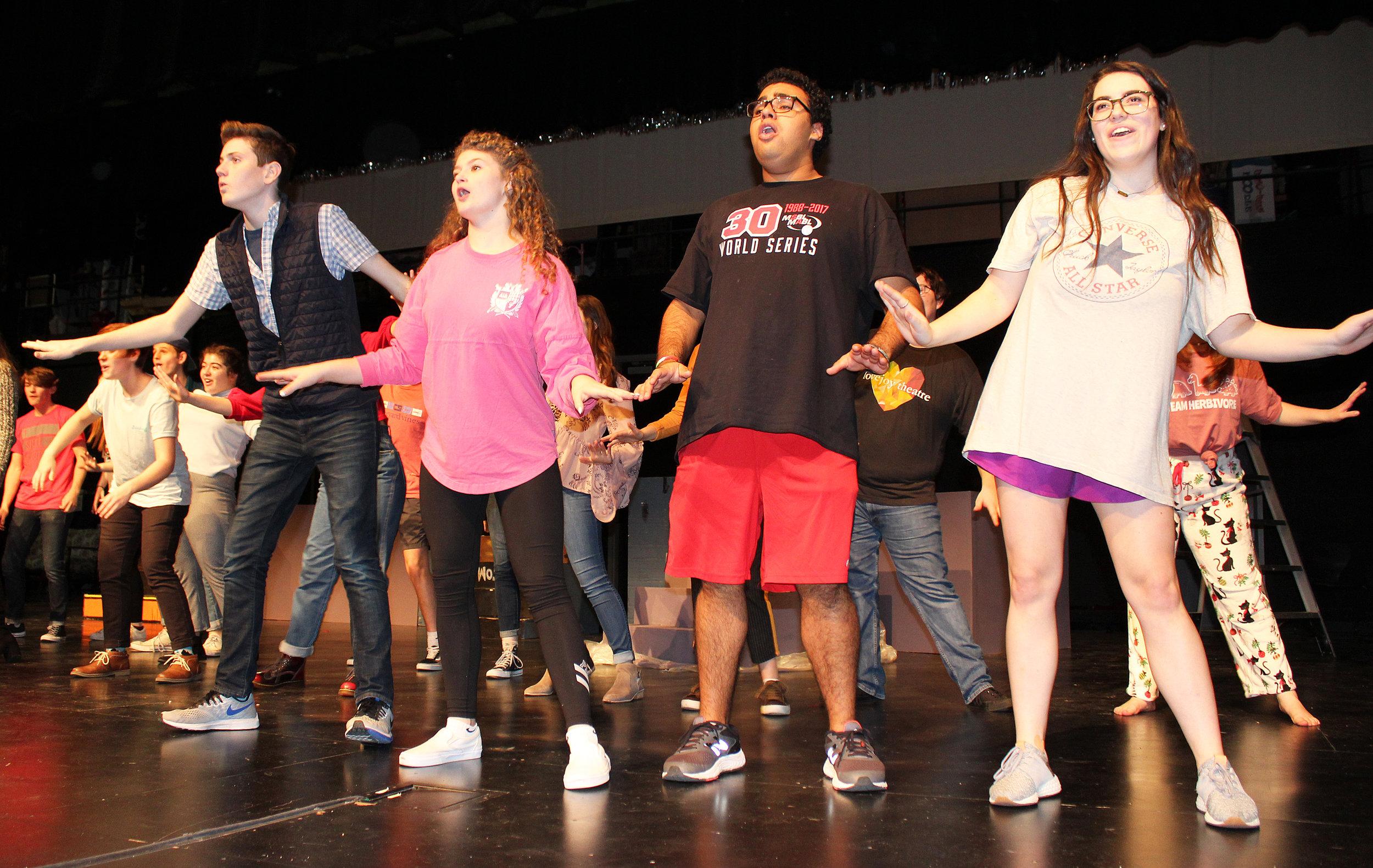 "Chorus members Jack Marsden, Audrey Hightower, Joey Chavez, Riley Bergwall rehearsing ""Shakin' at the High School Hop""."