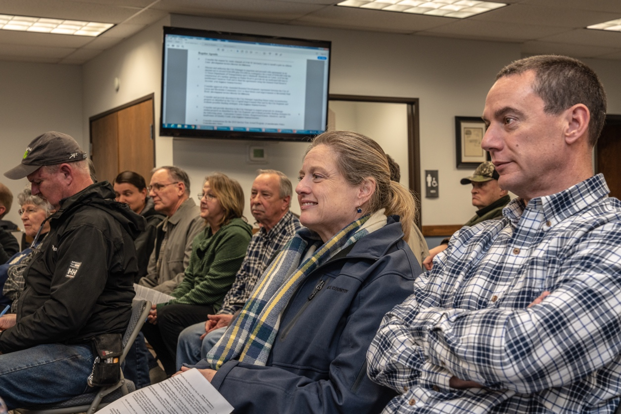 Residents of the Cimarron Trail neighborhood anxiously await the council's consideration for building a left turn lane along Parker Road to ease access to their neighborhood. When the council approved the proposal, they responded with a standing ovation.