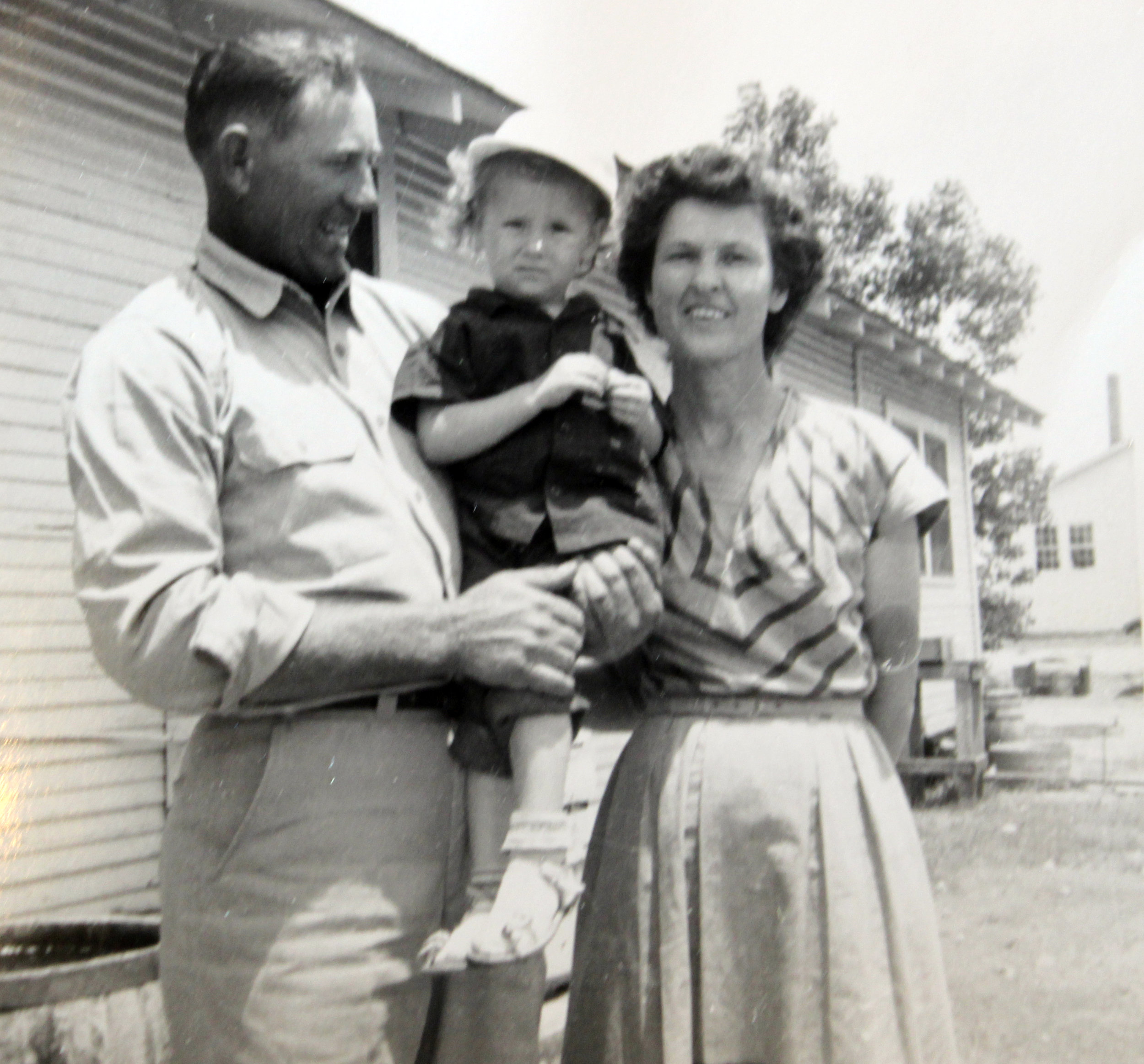 Billy and Mac McDonald, holding Debby, in front of their Winningkoff house in 1952.