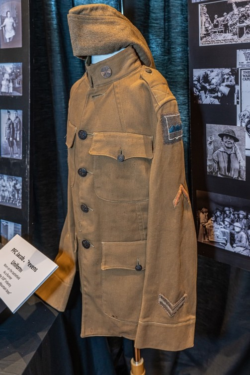 "PFC Jacob Steven's uniform. Steven's ran messages between outposts during combat and was one of the 2% of messengers who survived the war. He stood five feet tall and had a 24"" waist."