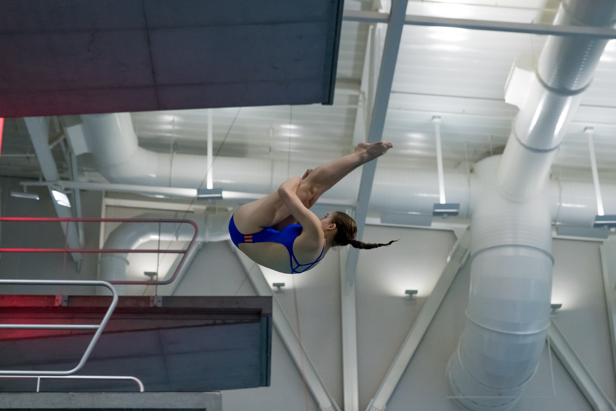 Ana is doing a 403b, an inward 1 1/2 pike, on the 3-meter platform.