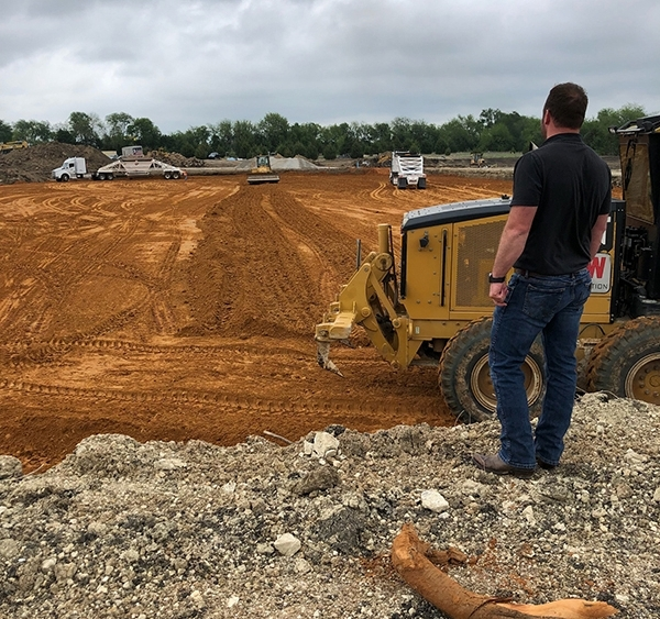 construction site of trucks and red dirt
