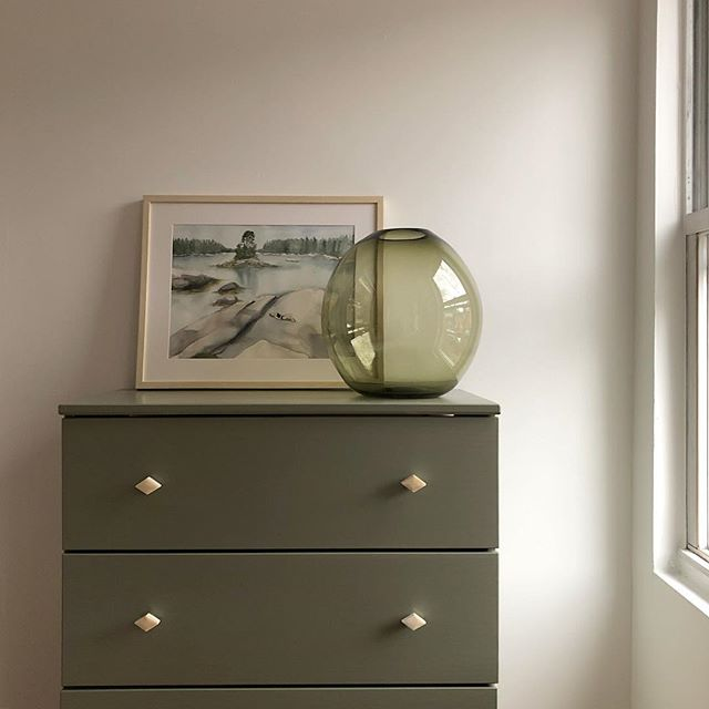"""Ikea hacking"" up a storm on this rainy Sunday @farrowandball 's new color #treron and @cb2 knobs 🌿 watercolor is my own...of one of my favorite spots in Maine."