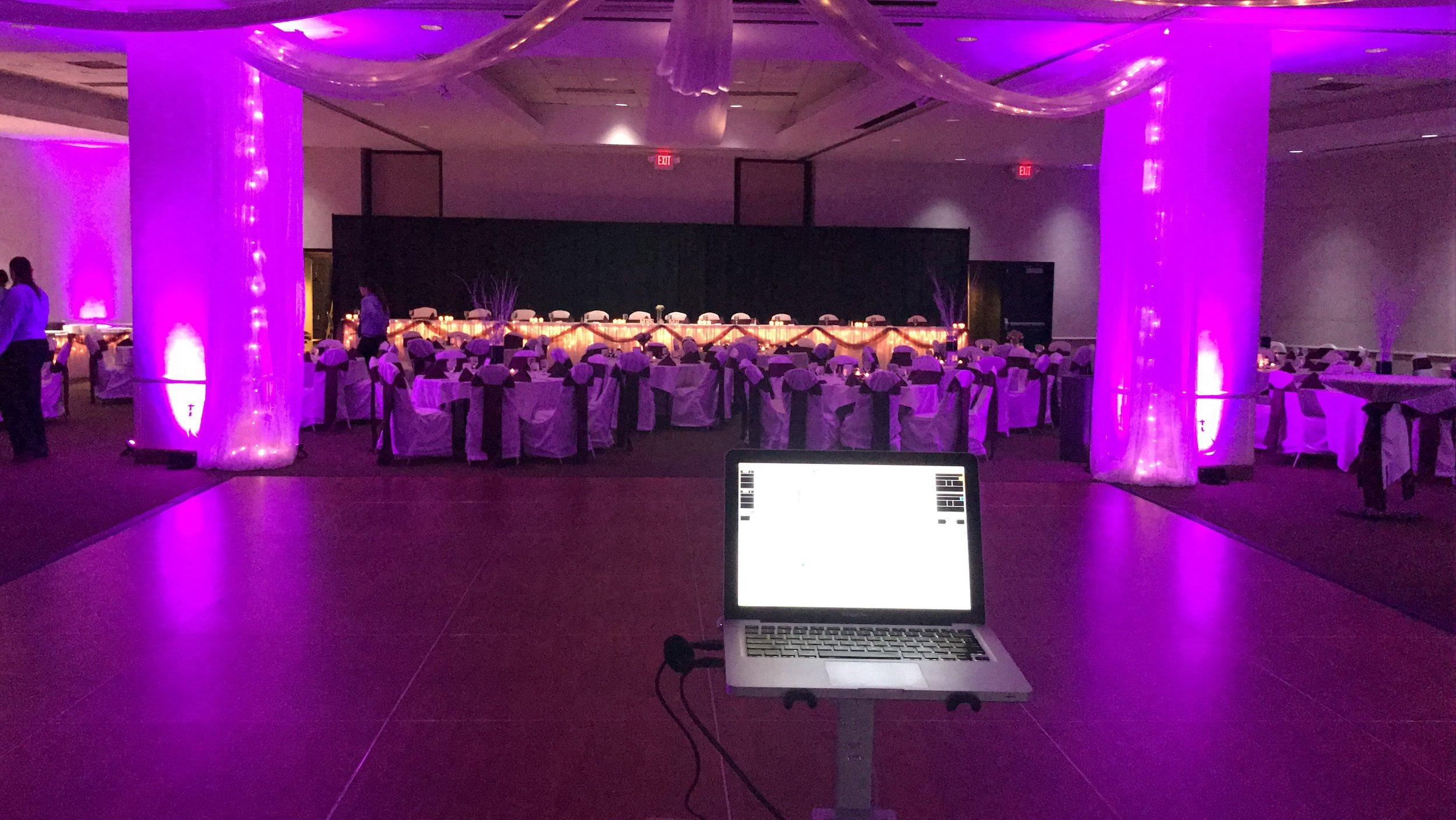 Wedding DJ set up with uplighting