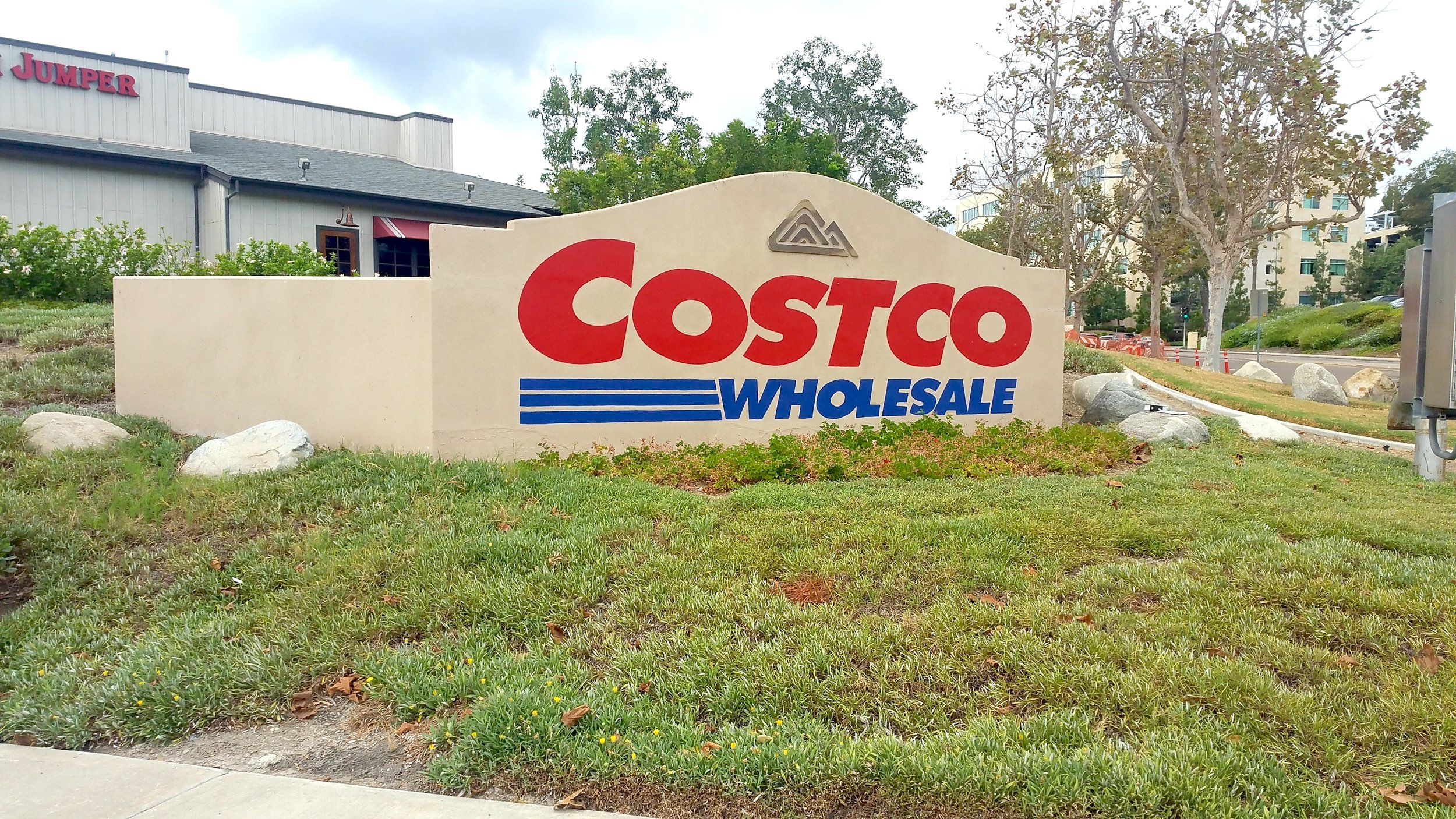 Hand painted sign at Costco Carmel Mountain, San Diego — before photo