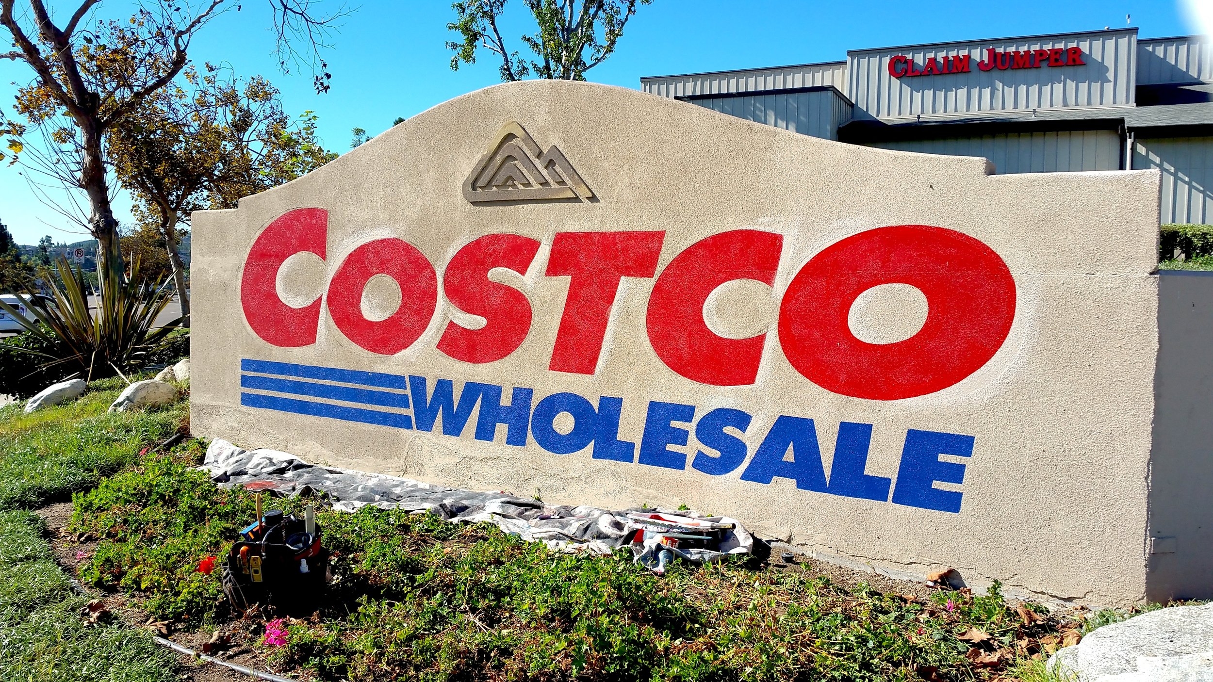 Hand painted sign at Costco Carmel Mountain, San Diego — in progress