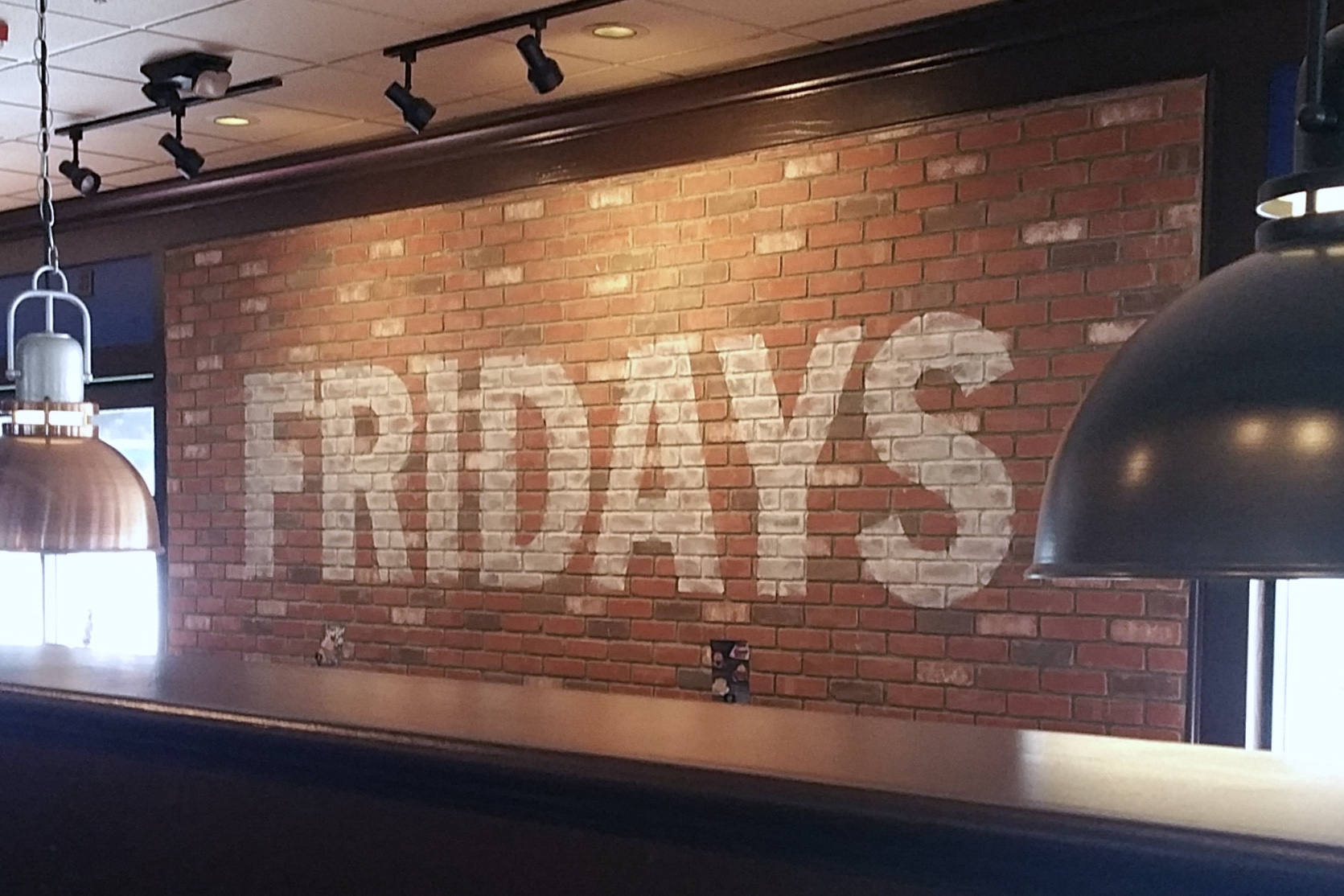 TGI Fridays hand painted ghost sign graphic mural