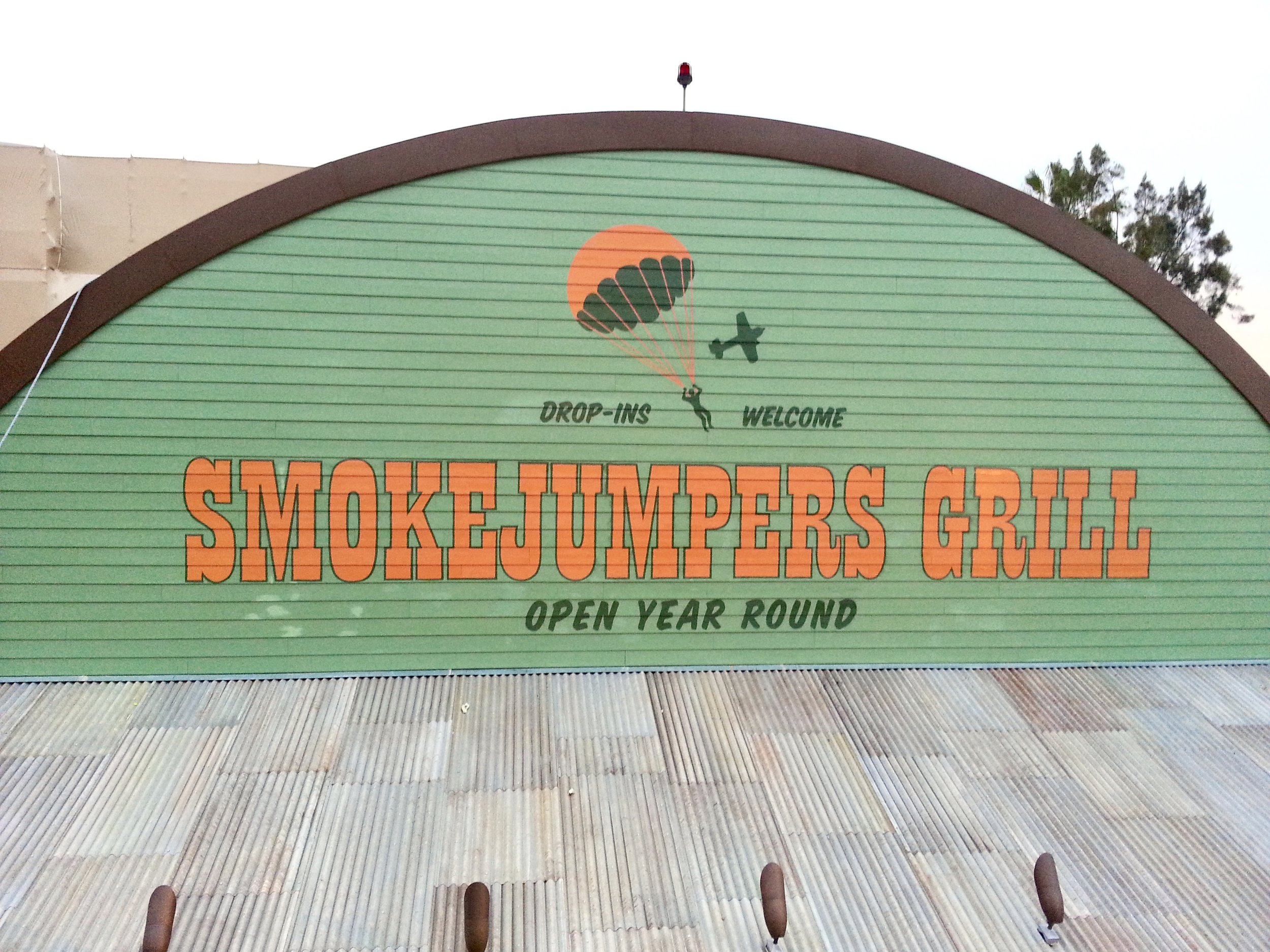 Smokejumpers Grill exterior hand painted distressed wall graphics