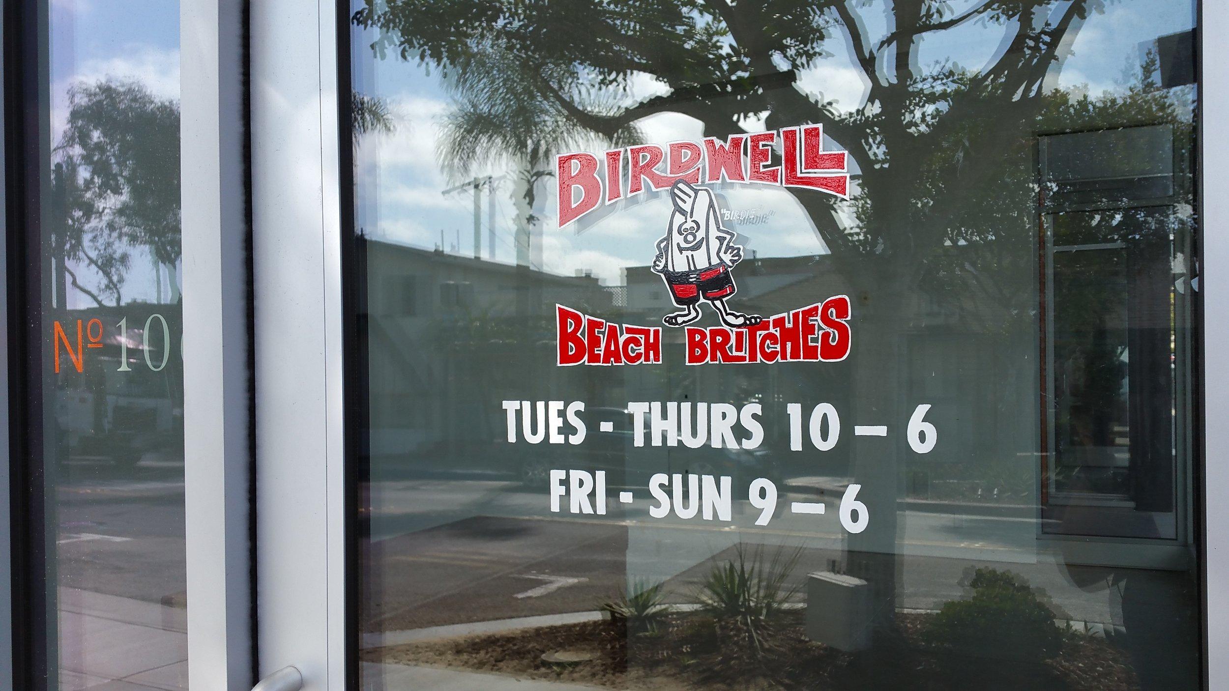 Birdwell Beach Britches hand lettered window sign detail