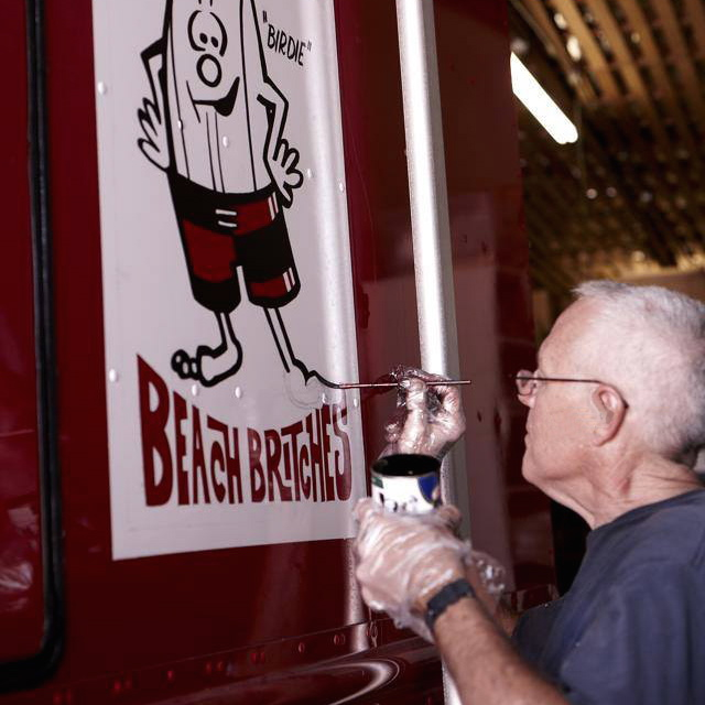 Birdwell Beach Britches hand lettered vehicle graphics - sign painter at work