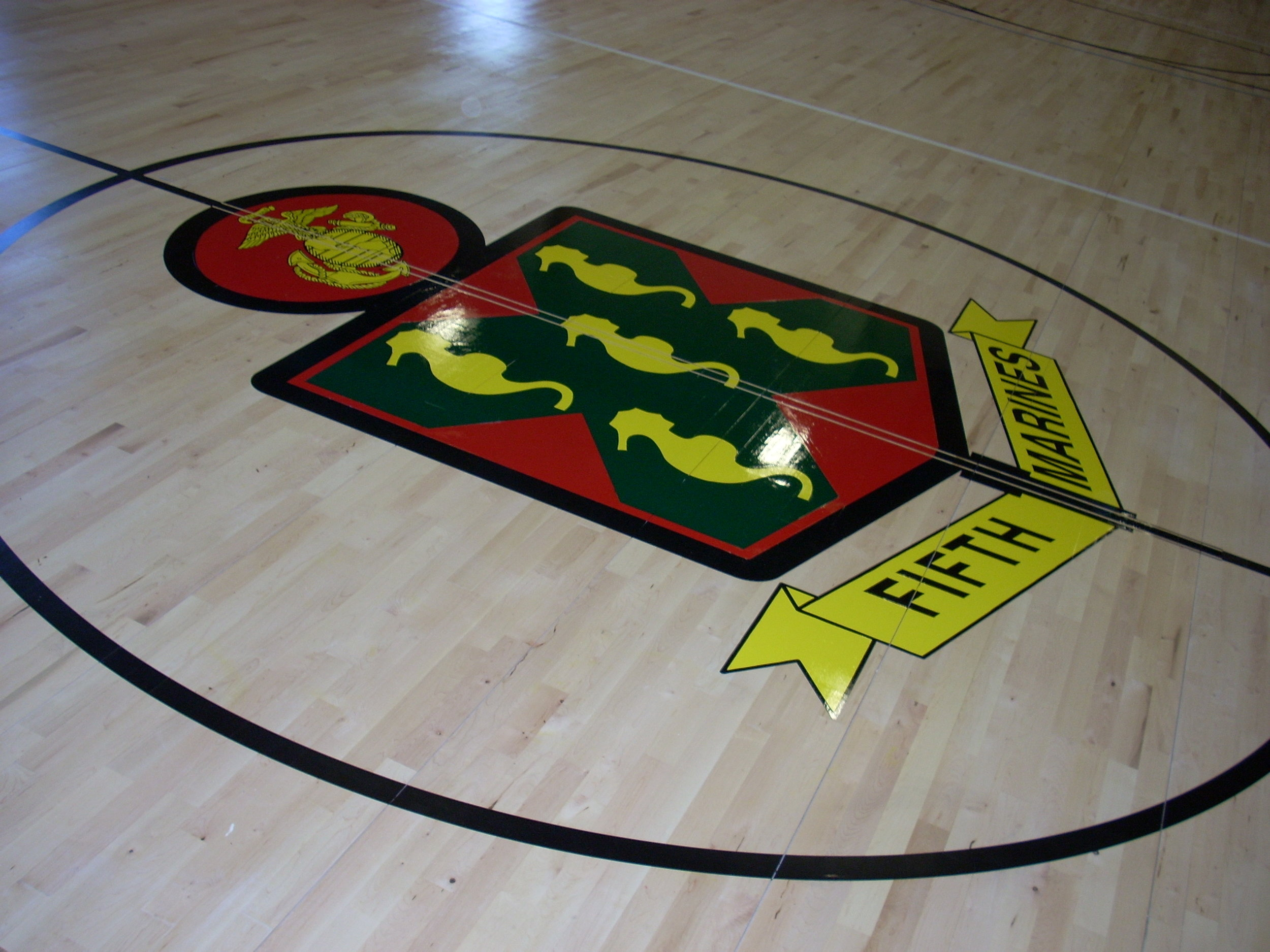 Fifth Marines gym wood floor hand painted graphics