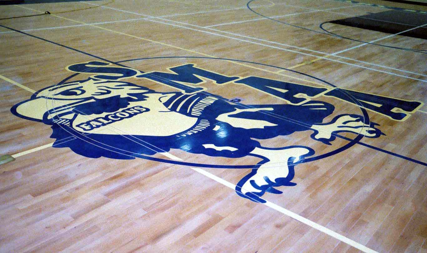 St. Mary's School gym wood floor hand painted graphics