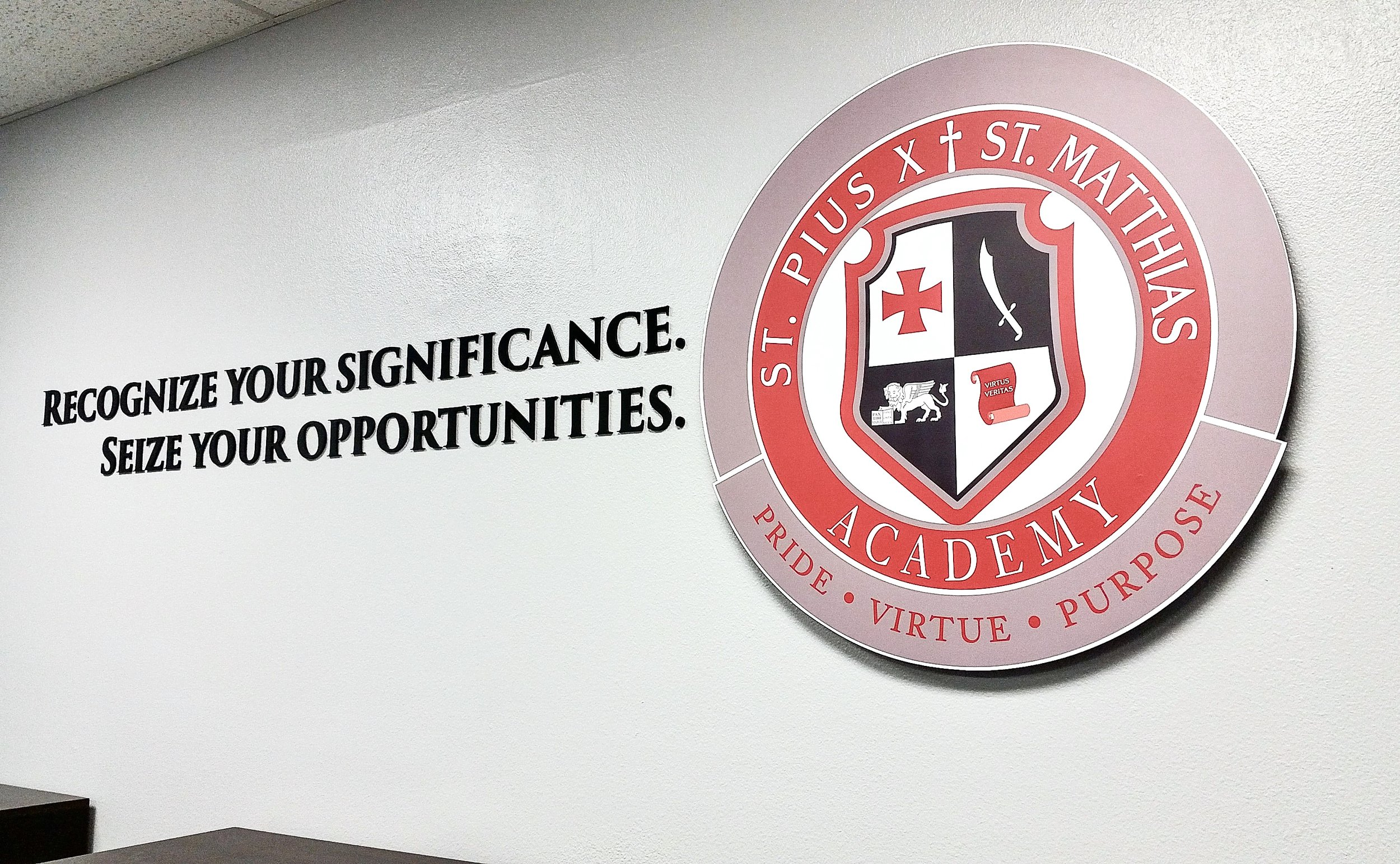 Pius Matthias Academy conference room dimensional logo and letters display
