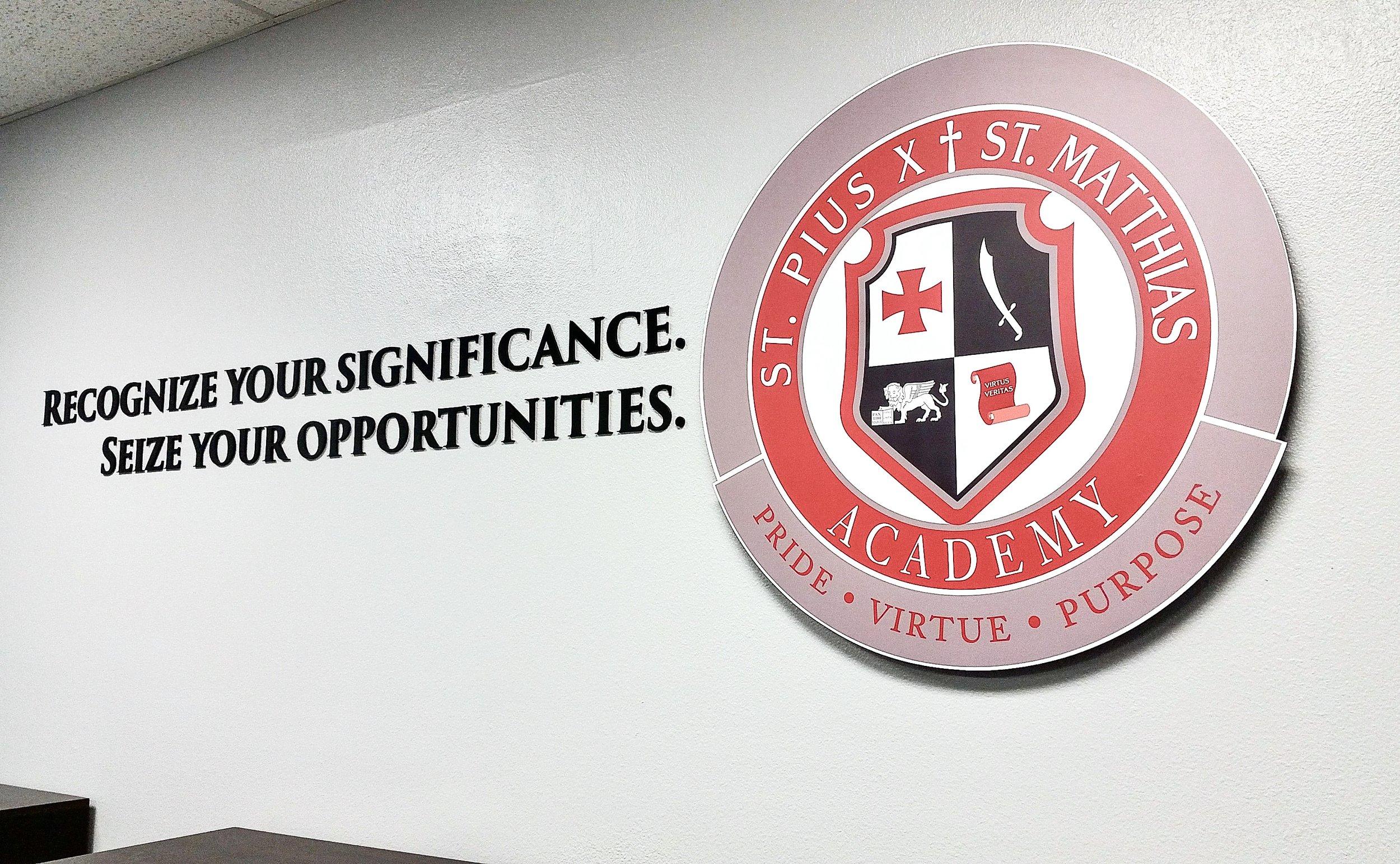 Pius Matthias Academy conference room dimensional logo display