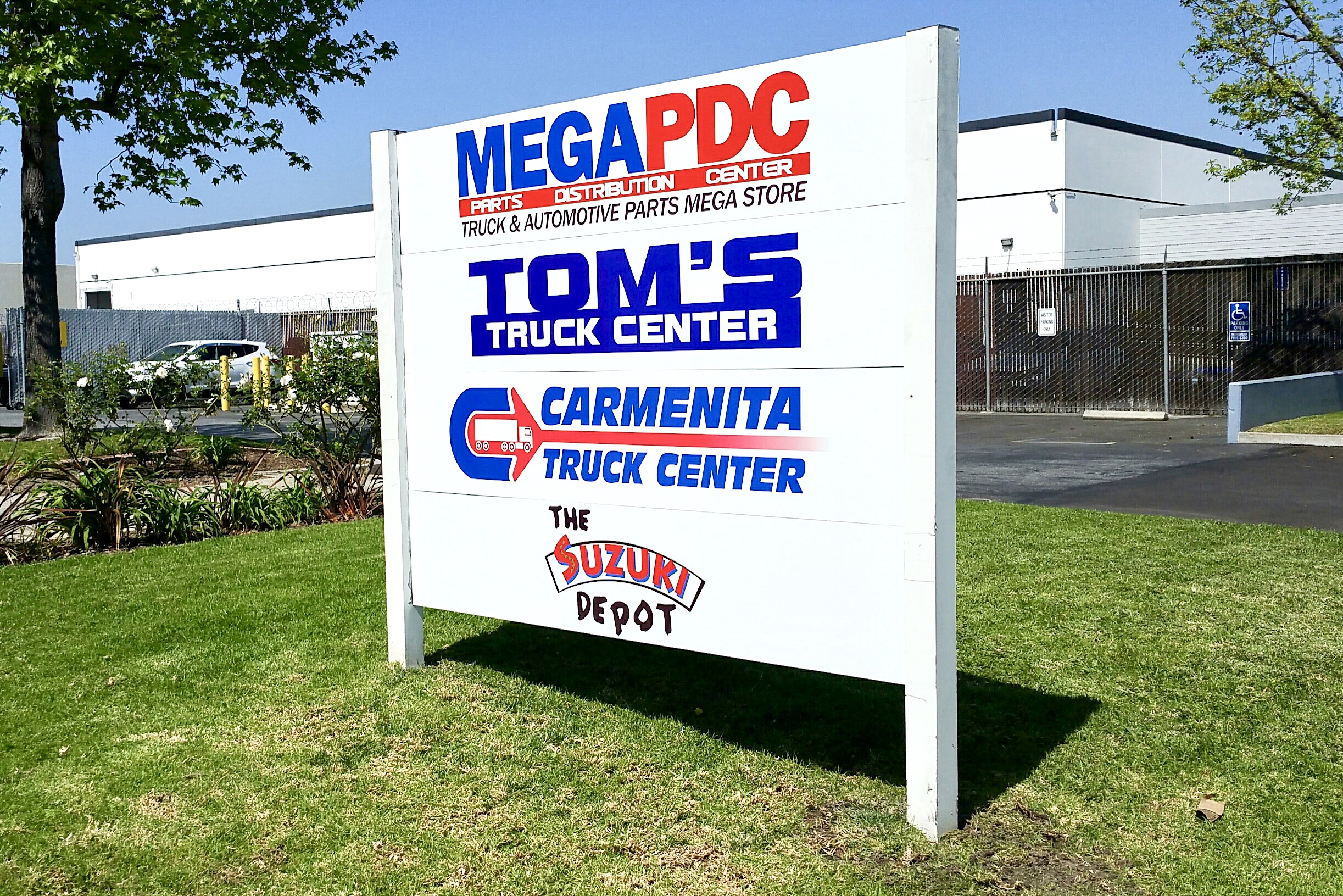 Tom's Truck Center post & panel sign