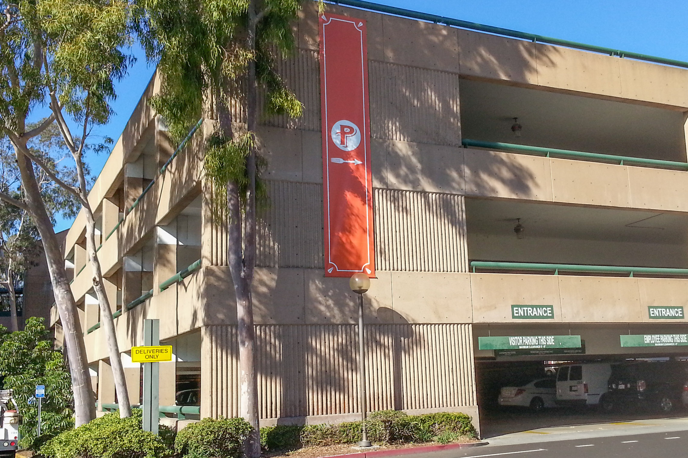 Vinyl banner being used as a parking directional sign - Anaheim Packing District