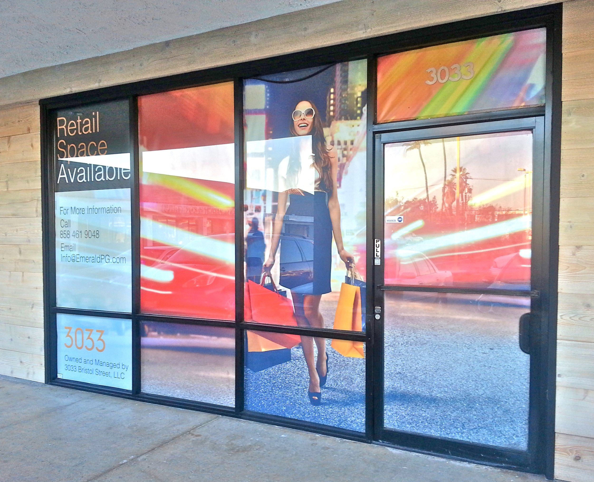 Banner material here is digitally printed and installed inside the window glass with 2-sided clear tape around the edges of each pane. This was an inexpensive alternative to doing a window wrap.