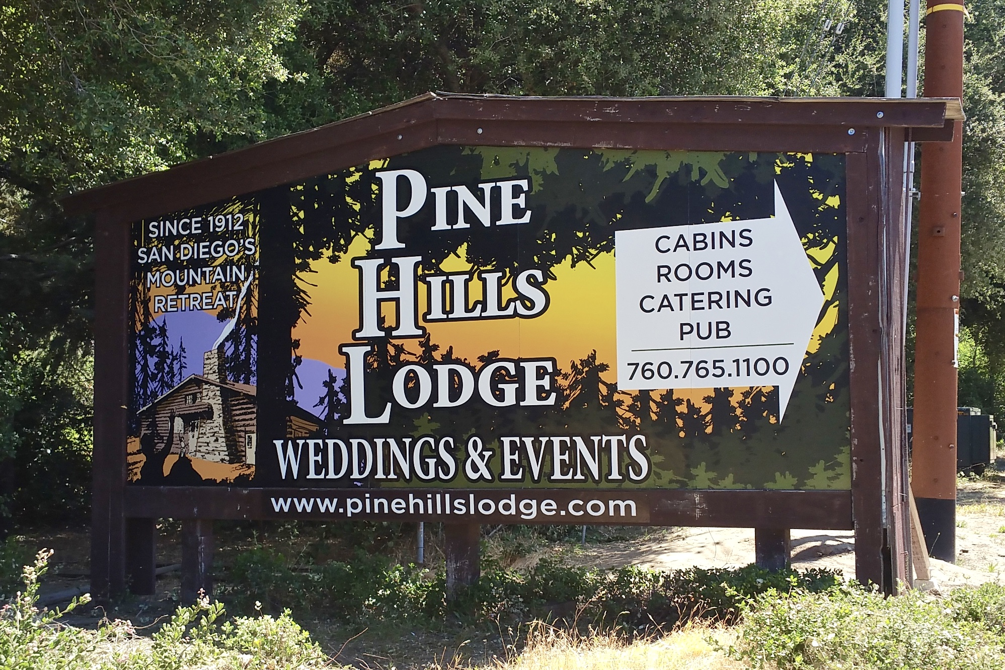 Pine Hills Lodge billboard monument sign