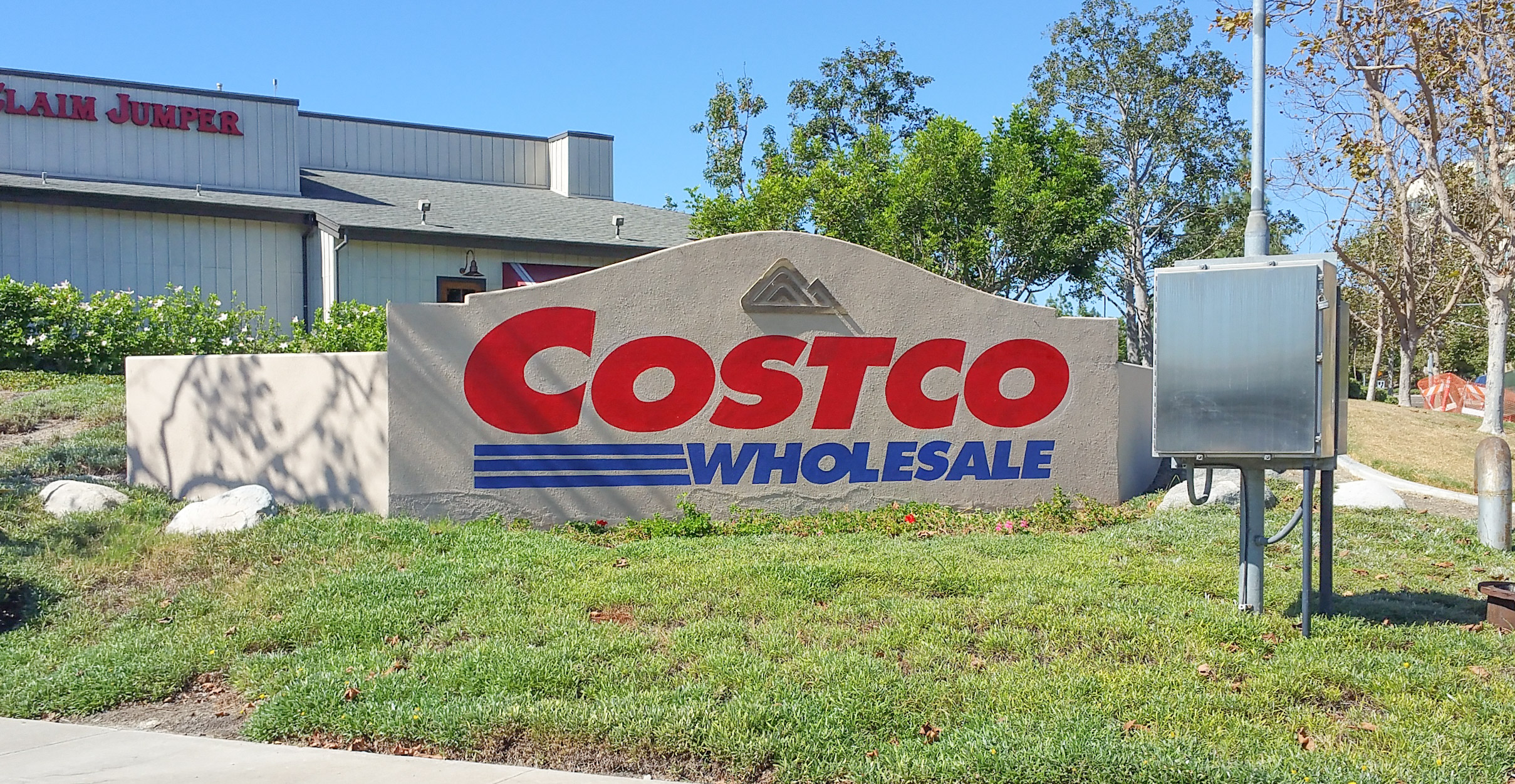 Costco Wholesale monument sign at Carmel Mountain in San Diego - hand painted graphics on an existing concrete block/stucco monument sign.