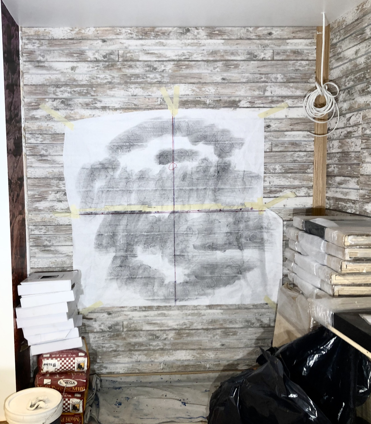 Working around construction sites at the late stage the I usually come into the picture often means I work around other trades — here some cabinetry, and tile ready for installation is temporary stored. The paper pattern with the design drawn full size is transferred with charcoal onto the surface.