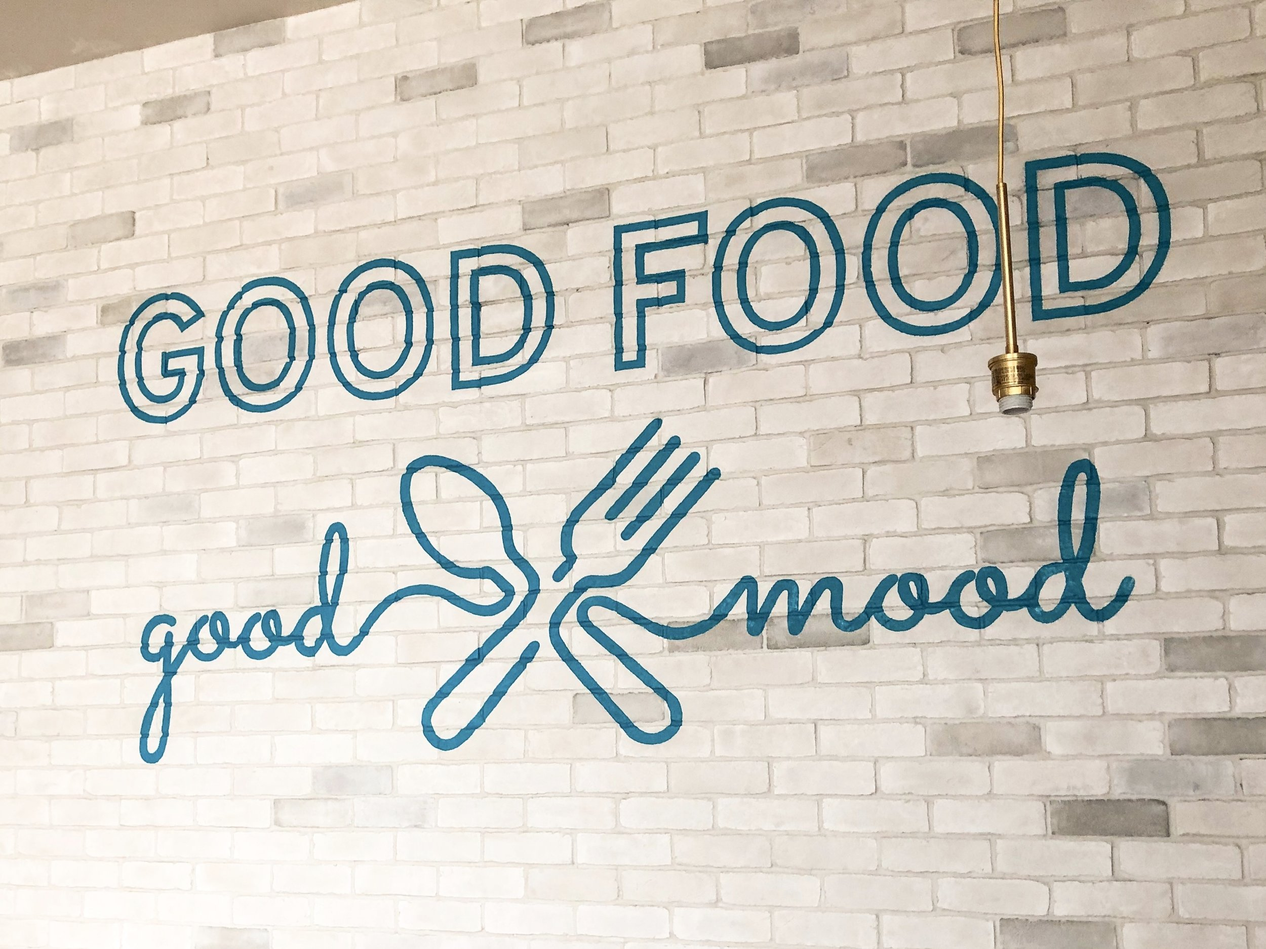 hand painted restaurant branding - brick wall graphic lettering in San Diego completion photo